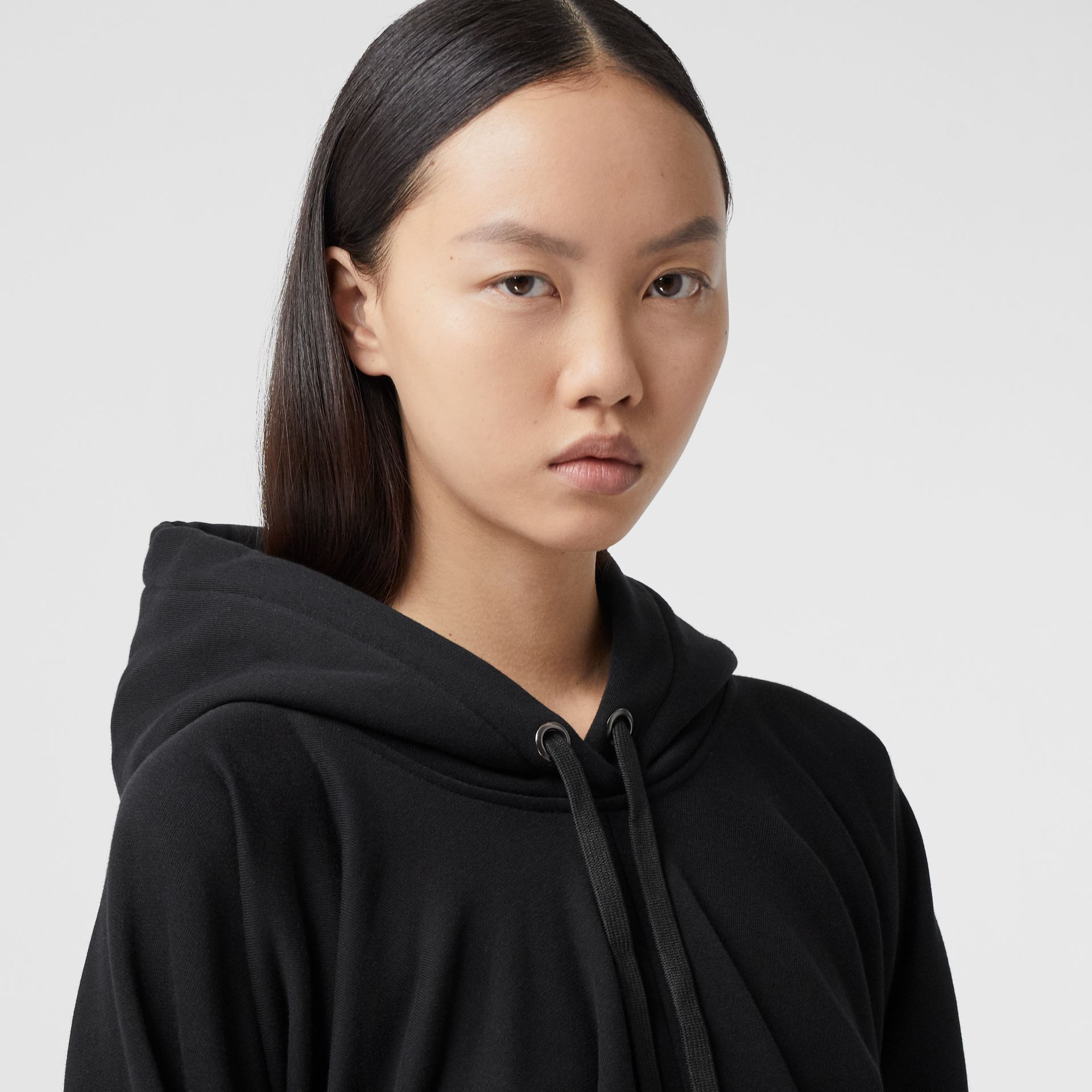 Location Print Gathered Cotton Oversized Hoodie in Black | Burberry United Kingdom - gallery image 1