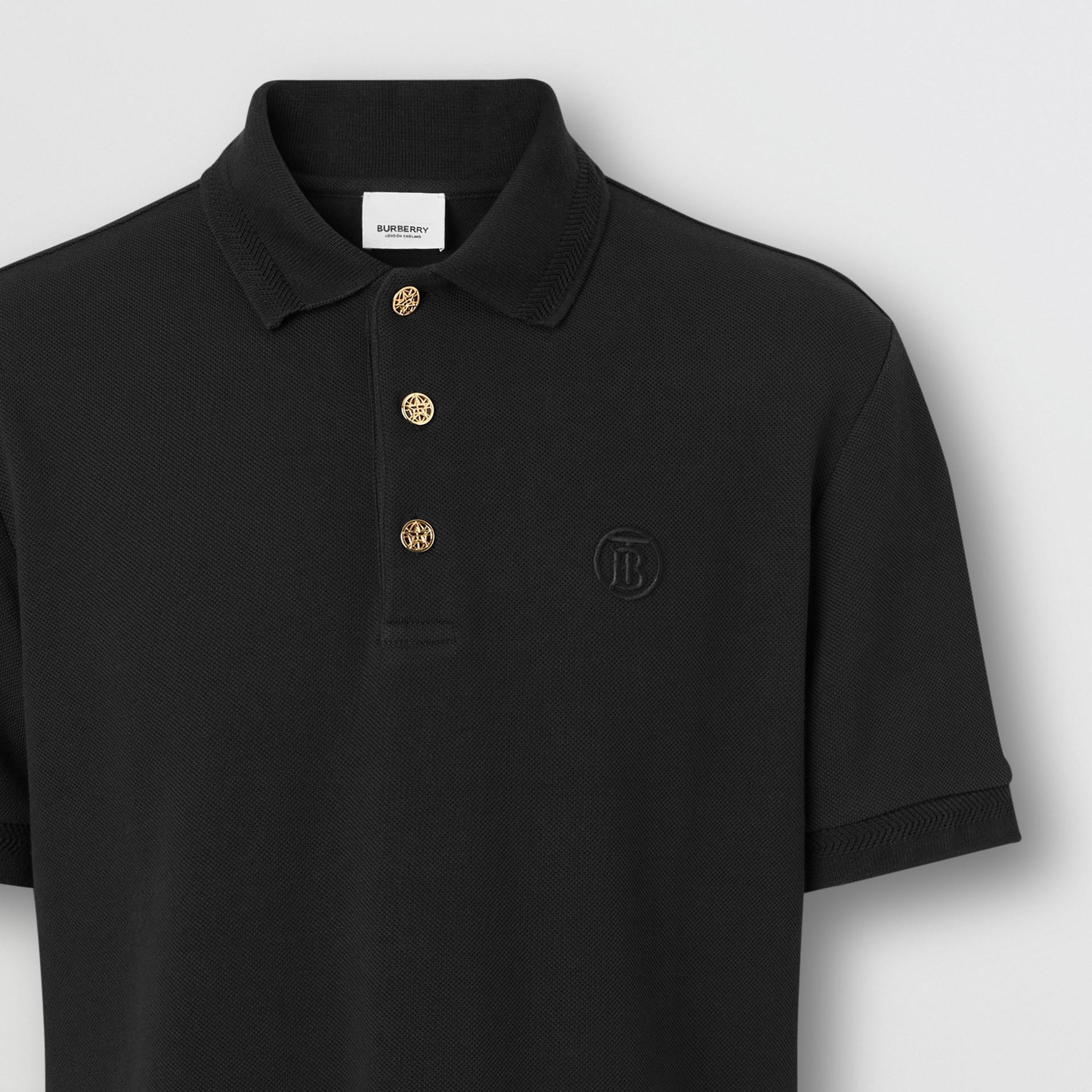 Camisa polo de algodão piquê com detalhe de botão (Preto) - Homens | Burberry - galeria de imagens 1