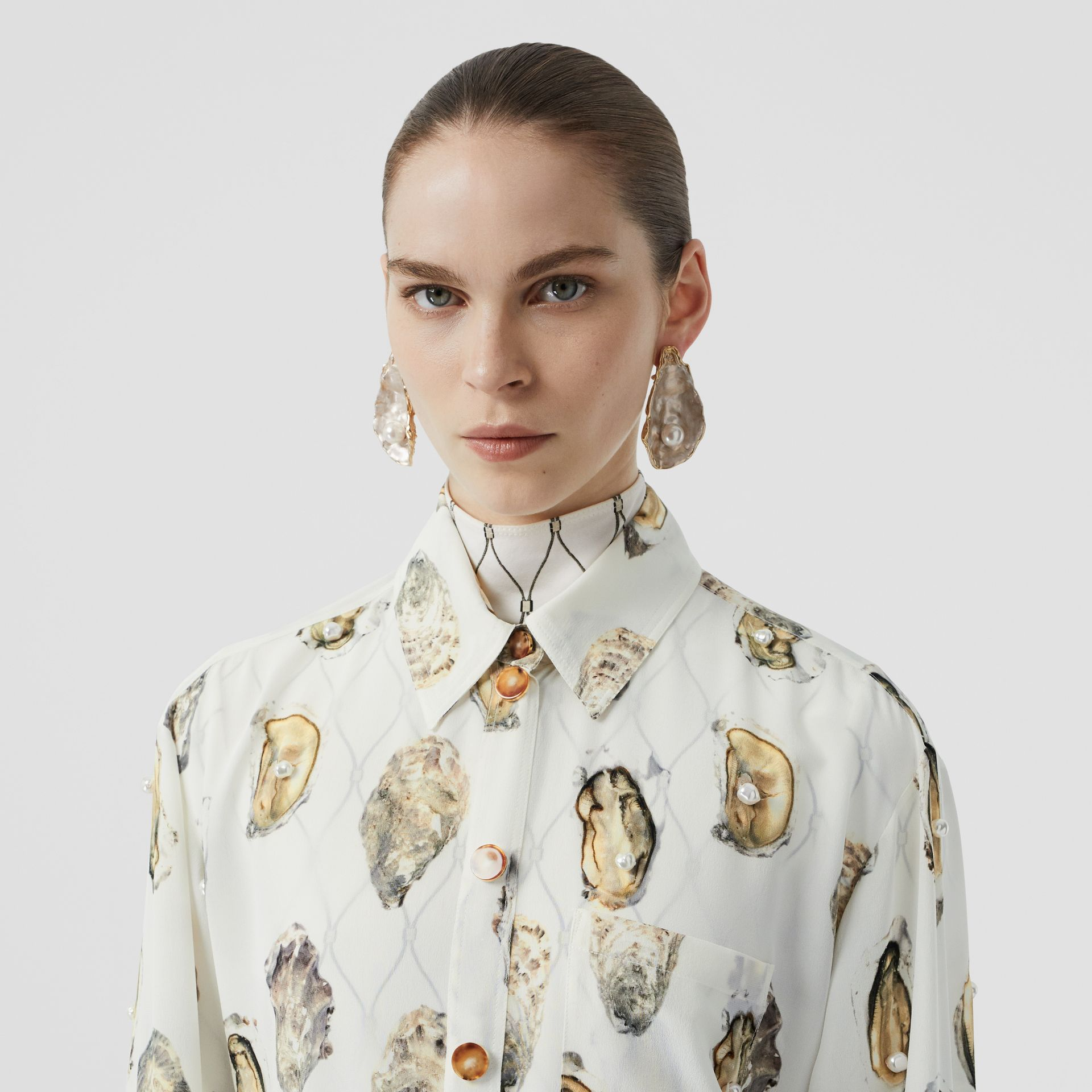 Embellished Oyster Print Silk Oversized Shirt in White - Women | Burberry - gallery image 1