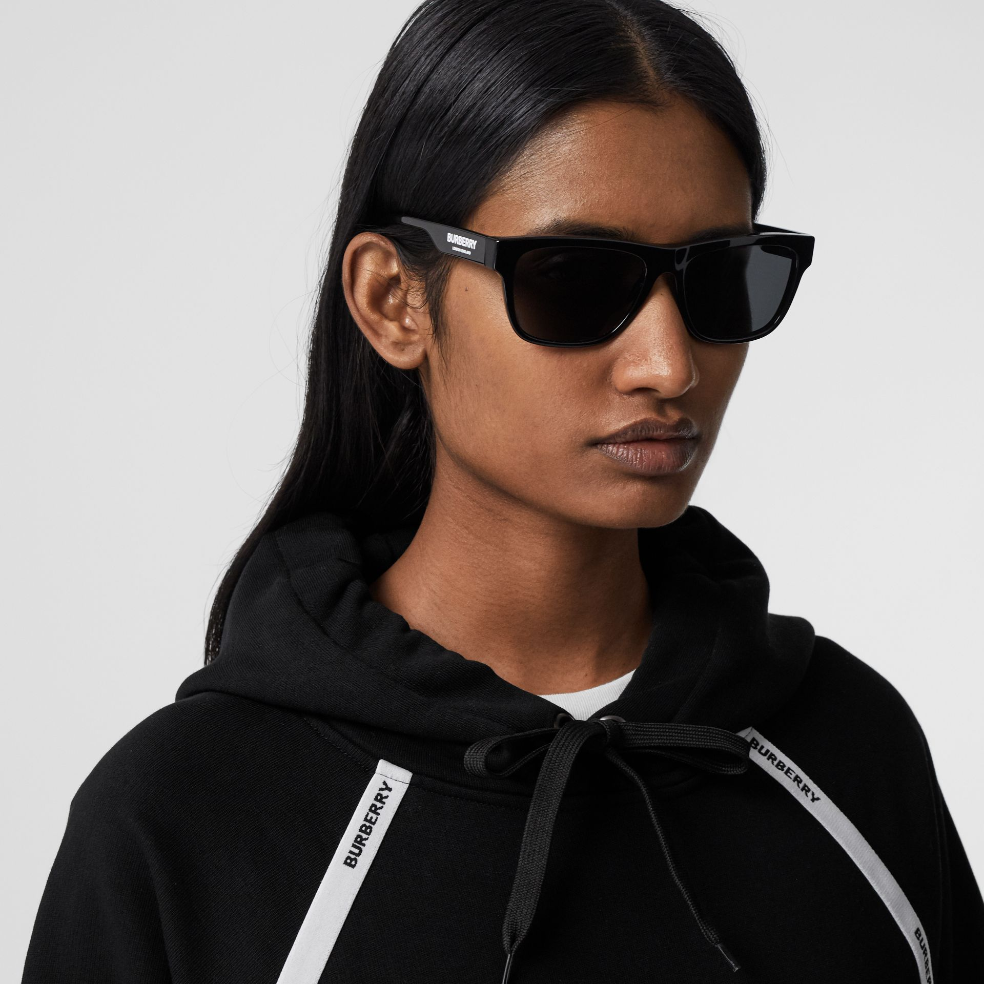 Logo Tape Cotton Oversized Hoodie in Black - Women | Burberry - gallery image 1