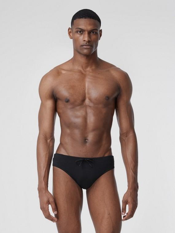 Bañador de slip con monograma y cordón ajustable (Negro)