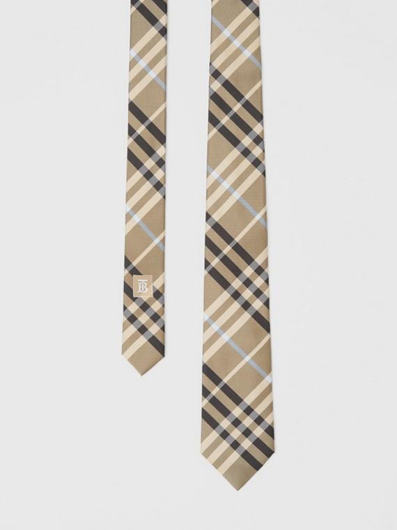 Gravata de seda com estampa xadrez e corte clássico (Areia Terroso)