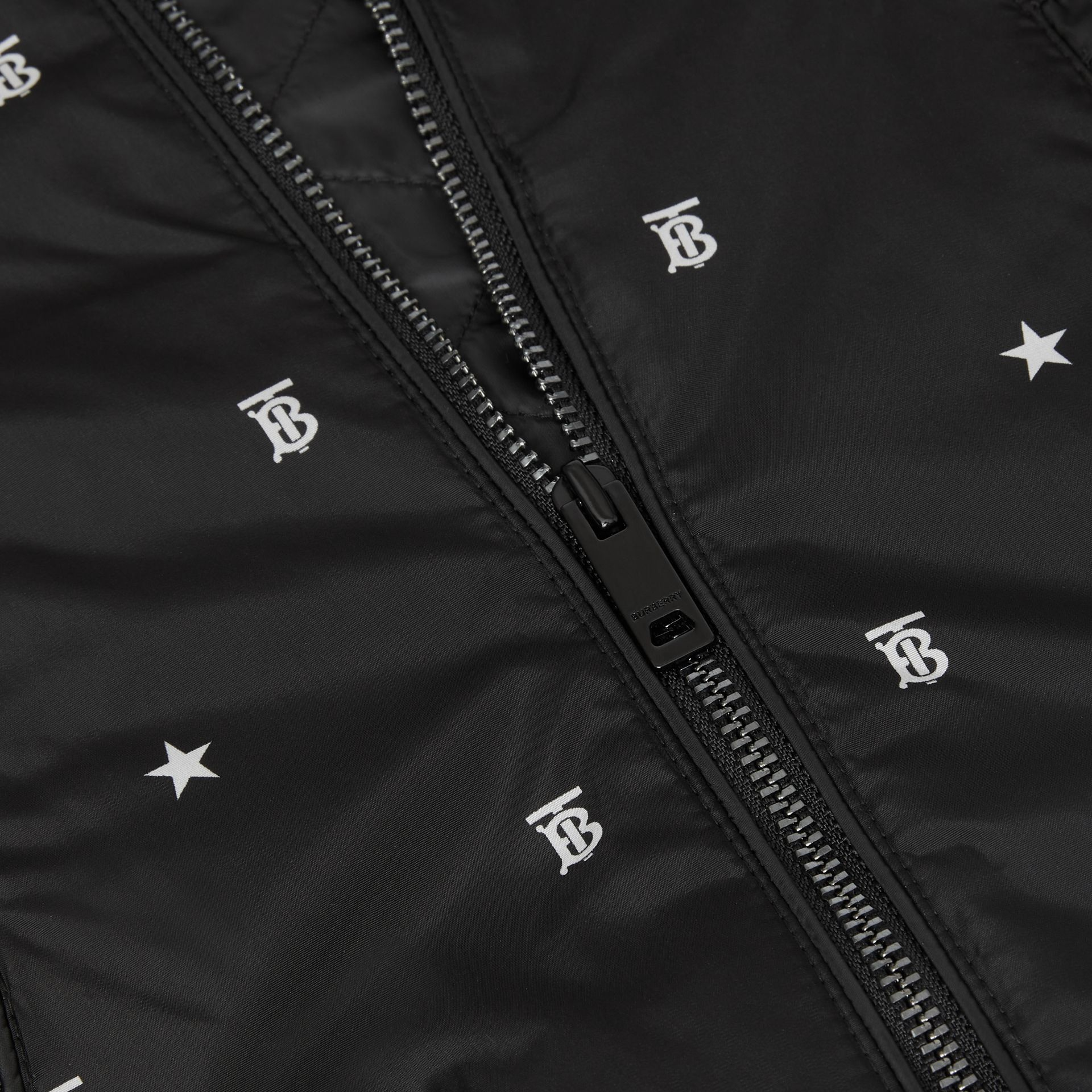 Star and Monogram Motif Lightweight Hooded Jacket in Black - Children | Burberry - gallery image 1