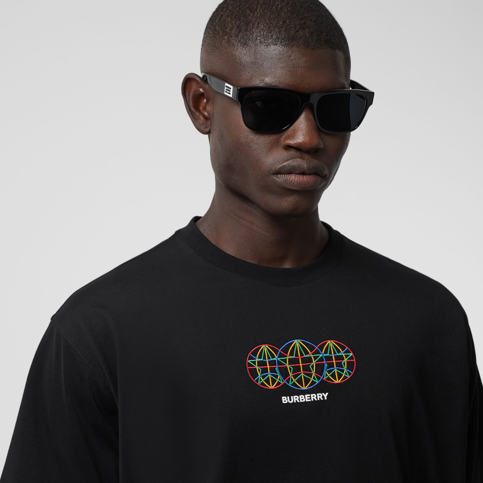 Embroidered Globe Graphic Cotton Oversized T-shirt in Black - Men | Burberry - gallery image 1