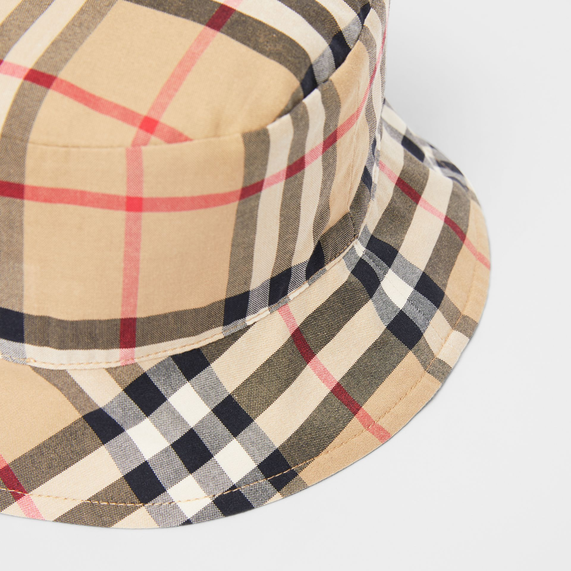 Reversible Vintage Check and Icon Stripe Bucket Hat in Archive Beige - Children | Burberry United Kingdom - gallery image 1