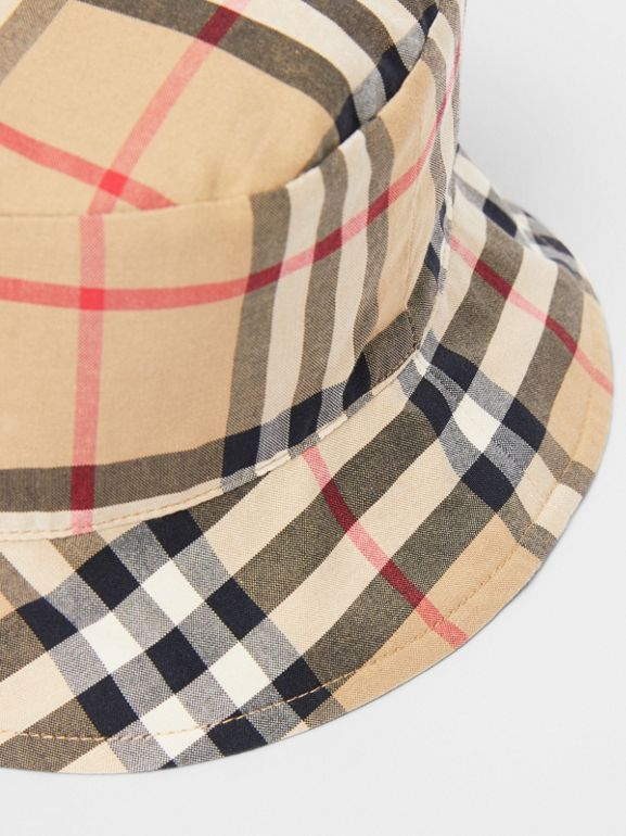 Reversible Vintage Check and Icon Stripe Bucket Hat in Archive Beige - Children | Burberry United Kingdom - cell image 1