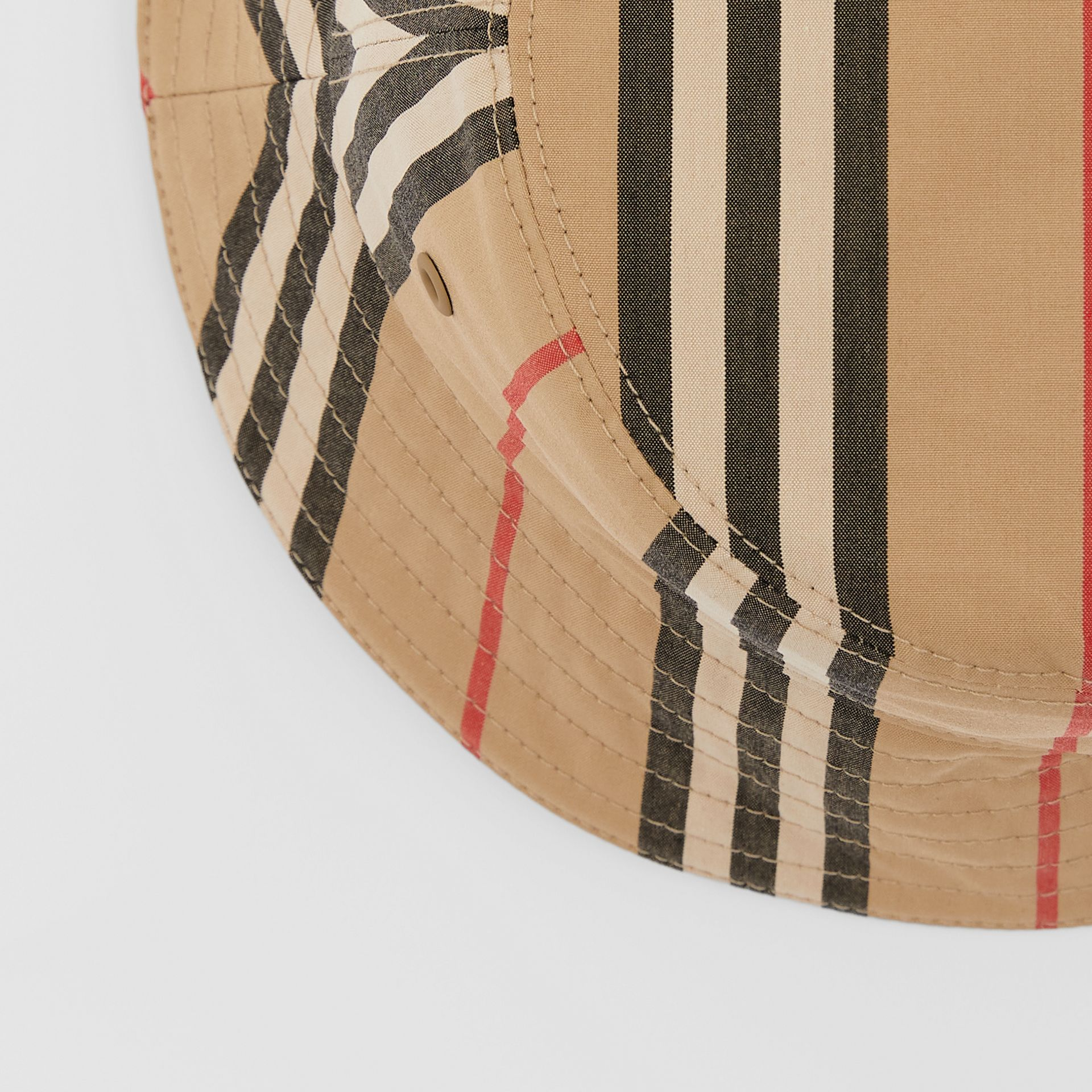 Reversible Icon Stripe Cotton Bucket Hat in Archive Beige | Burberry - gallery image 1