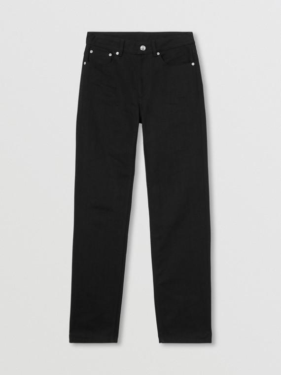 Jeans dal taglio dritto in denim grezzo con grafica con logo (Nero)