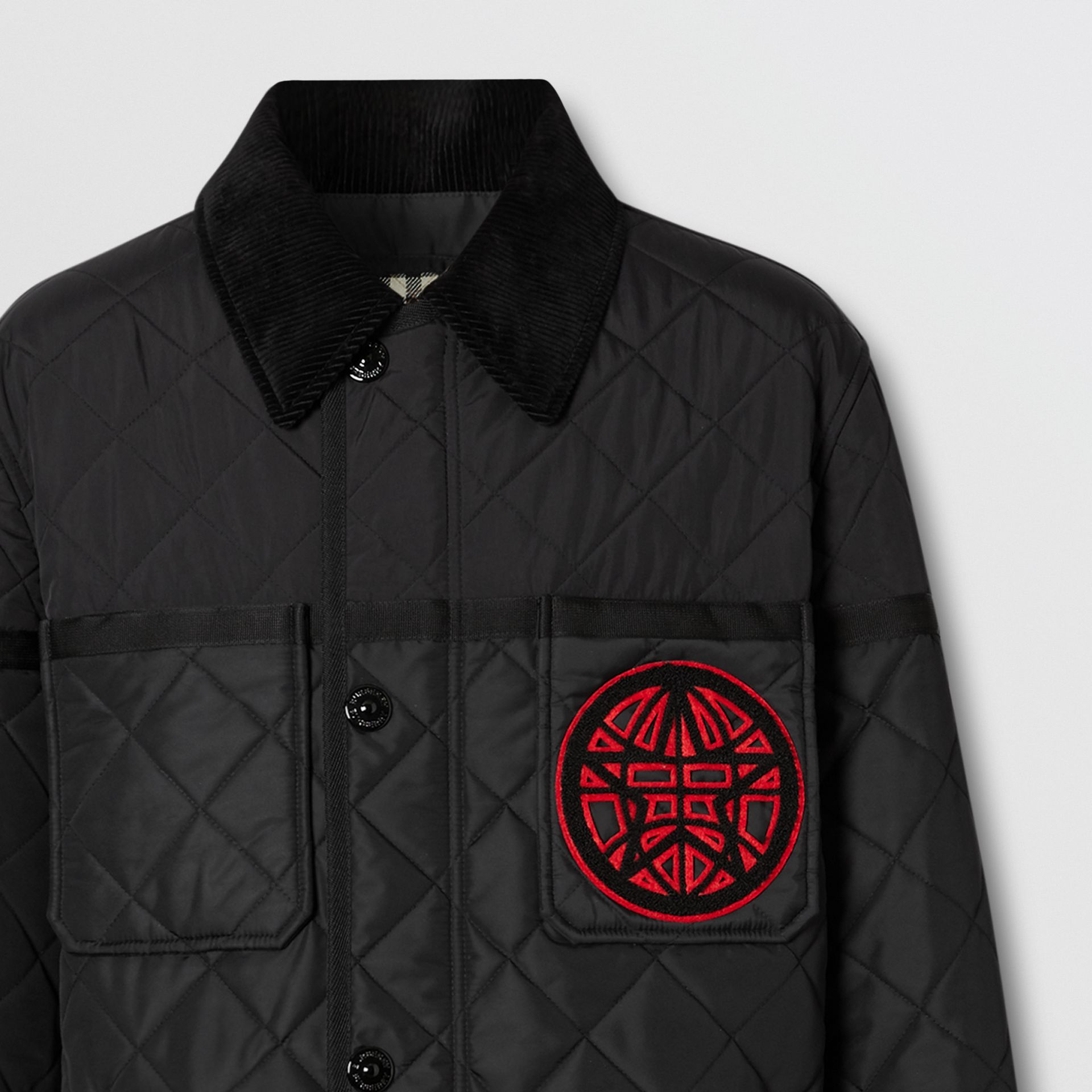 Varsity Graphic Diamond Quilted Barn Jacket in Black - Men | Burberry Canada - gallery image 1