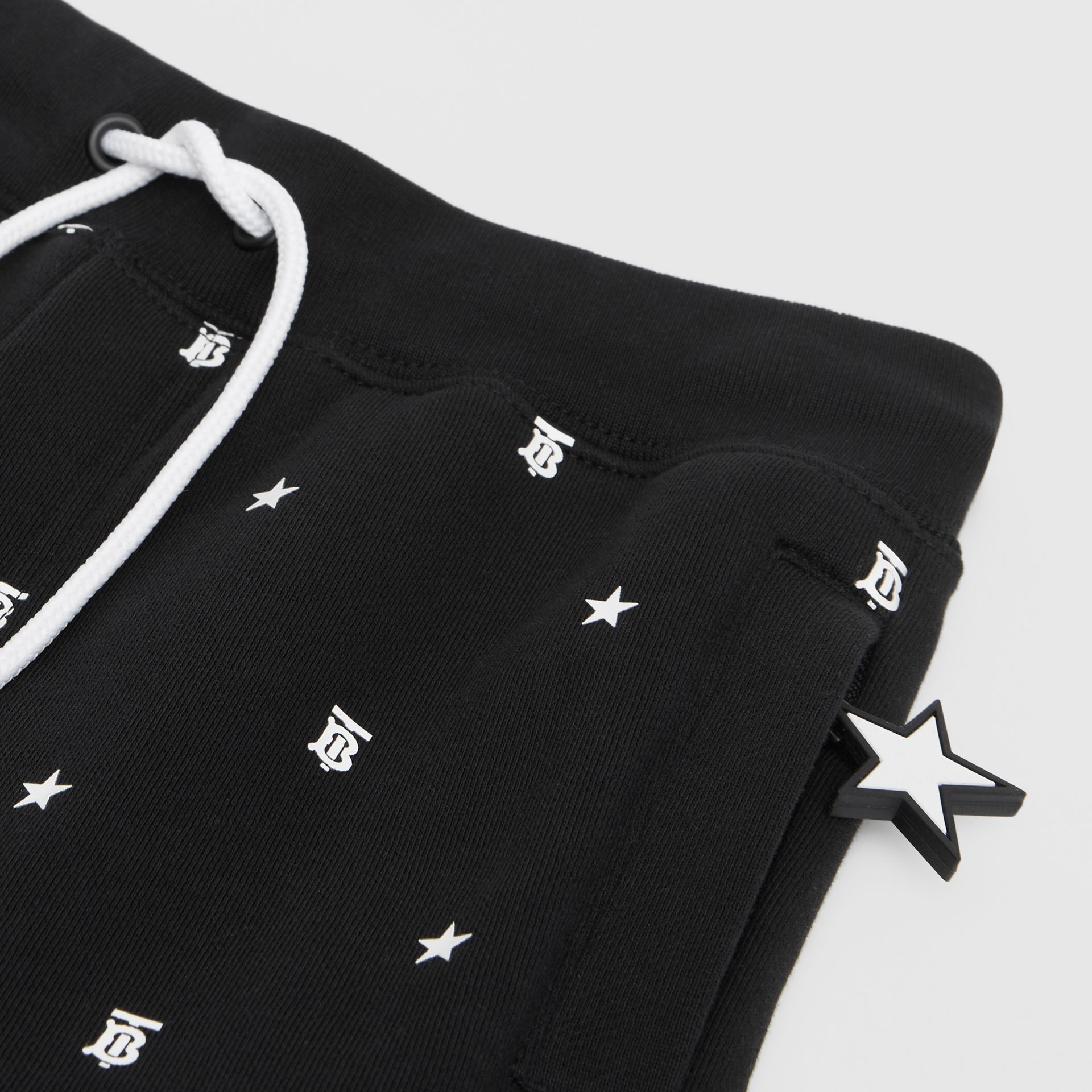 Star and Monogram Motif Cotton Jogging Pants in Black | Burberry Hong Kong S.A.R. - gallery image 1