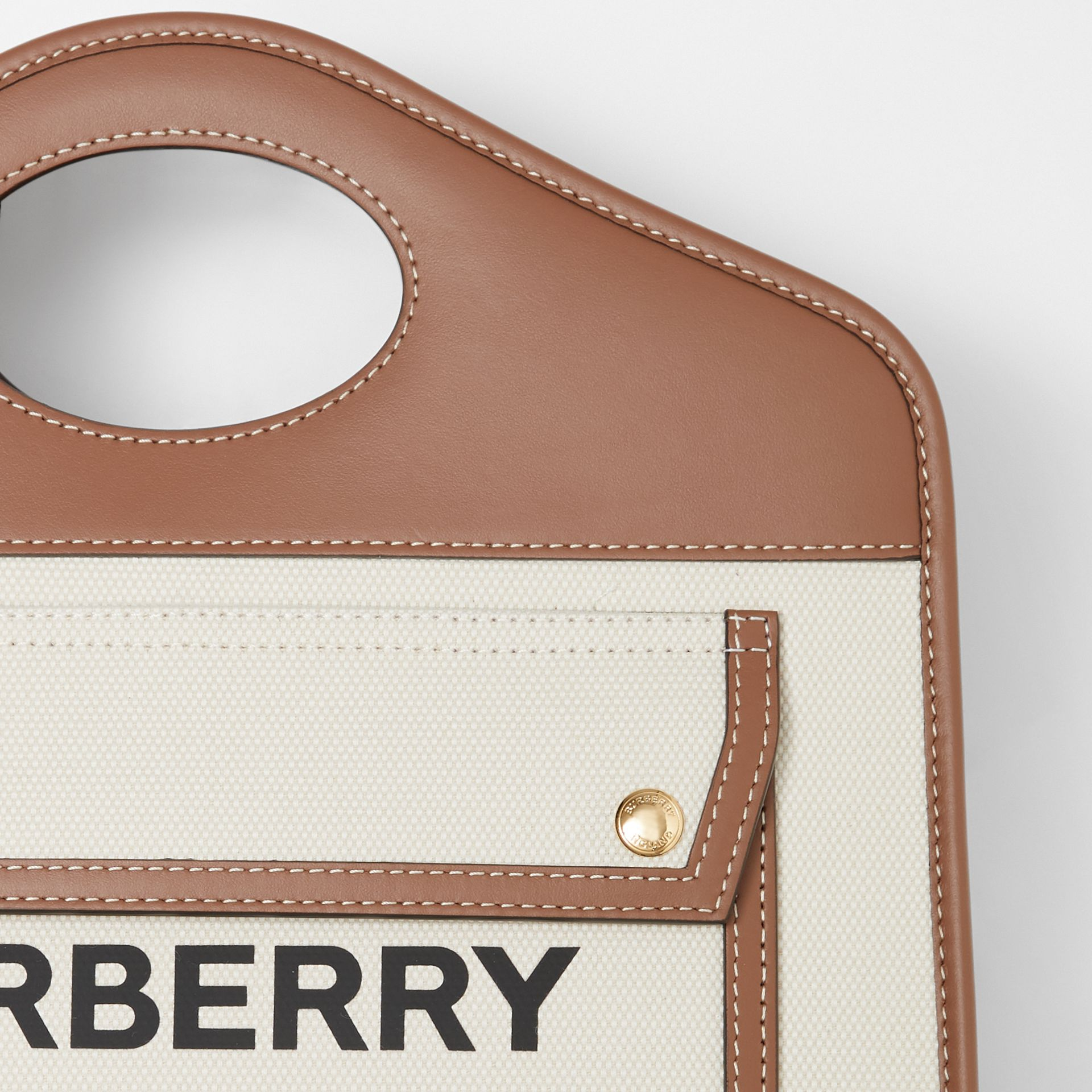 Small Two-tone Canvas and Leather Pocket Tote in Natural/malt Brown - Women | Burberry - gallery image 1