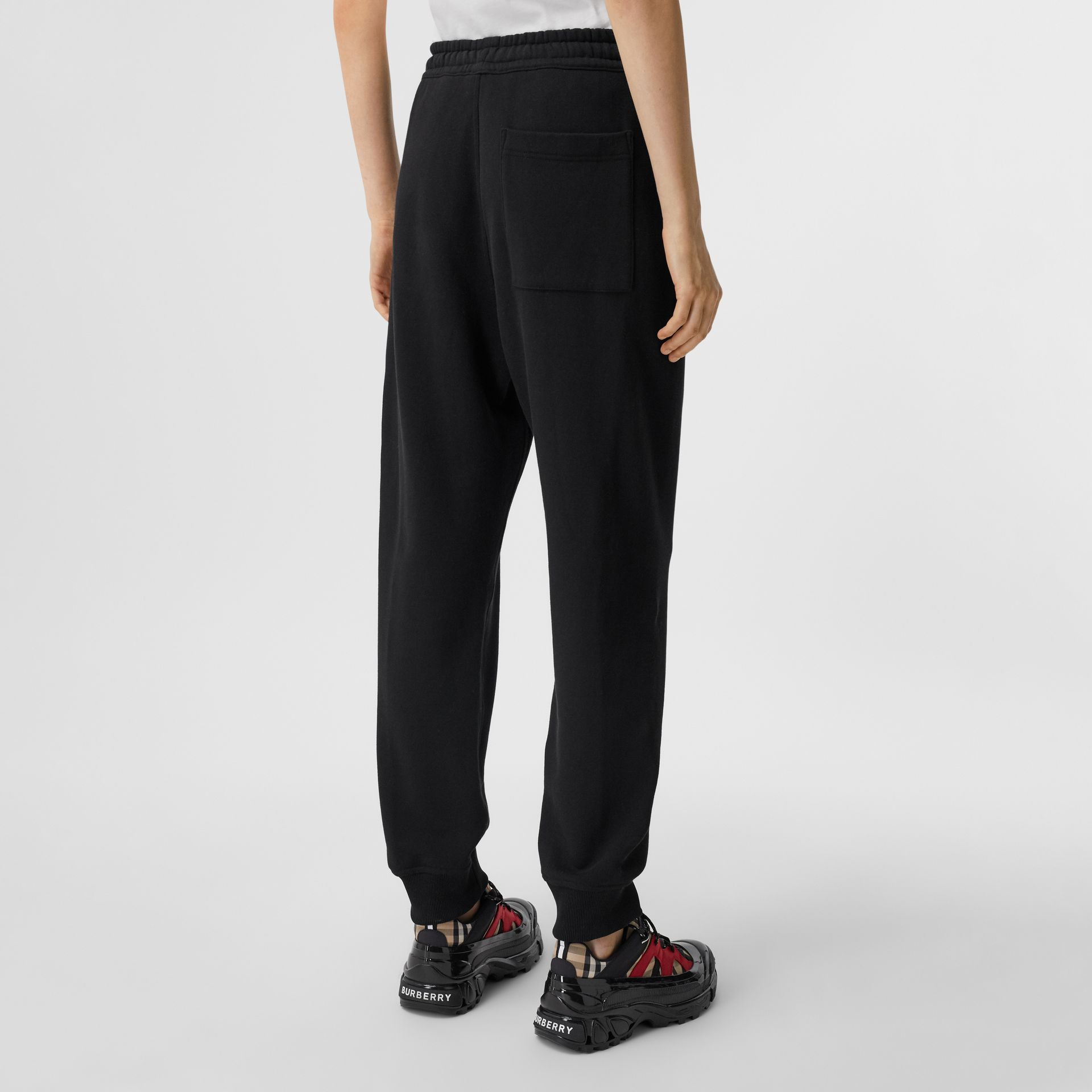 Logo Print Cotton Jogging Pants in Black - Women | Burberry - gallery image 2