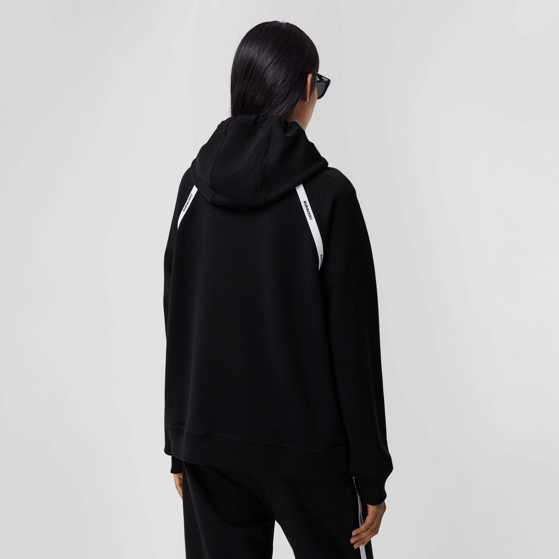 Logo Tape Cotton Oversized Hoodie in Black - Women | Burberry - gallery image 2