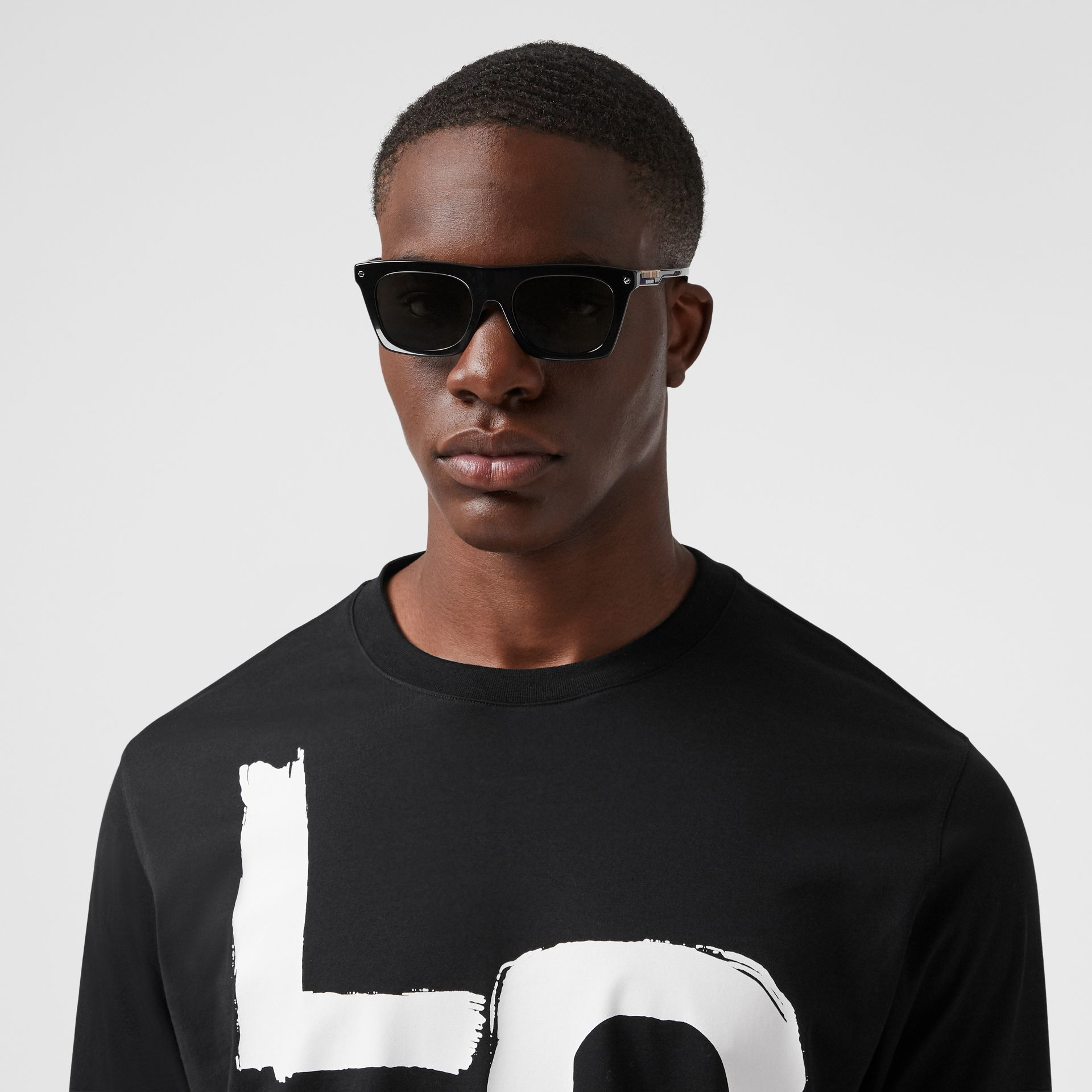 Long-sleeve Love Print Cotton Top in Black - Men | Burberry - gallery image 1