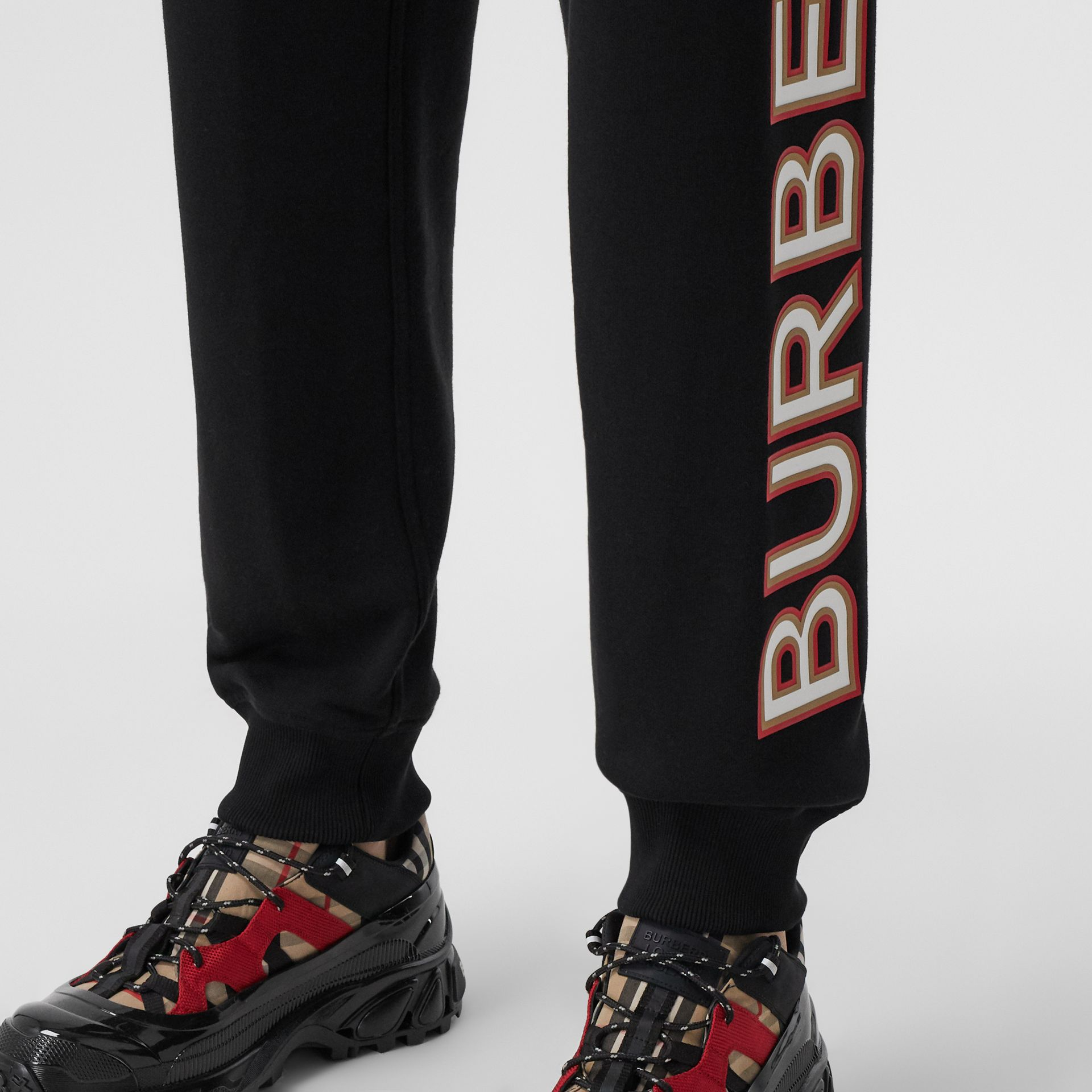 Logo Print Cotton Jogging Pants in Black - Women | Burberry - gallery image 1