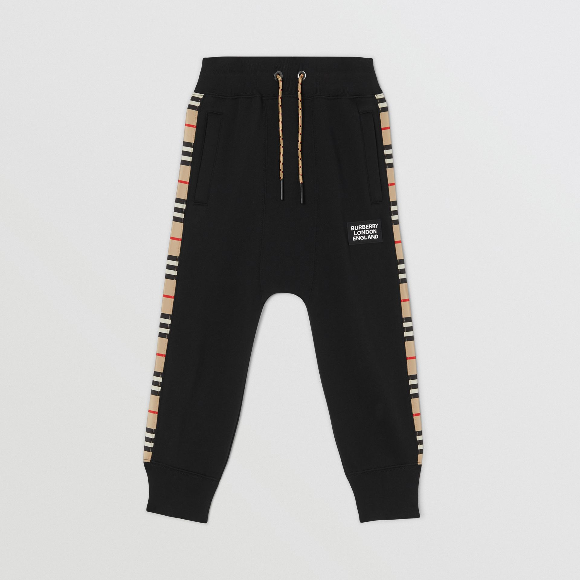 Icon Stripe Panel Cotton Trackpants in Black | Burberry United Kingdom - gallery image 0