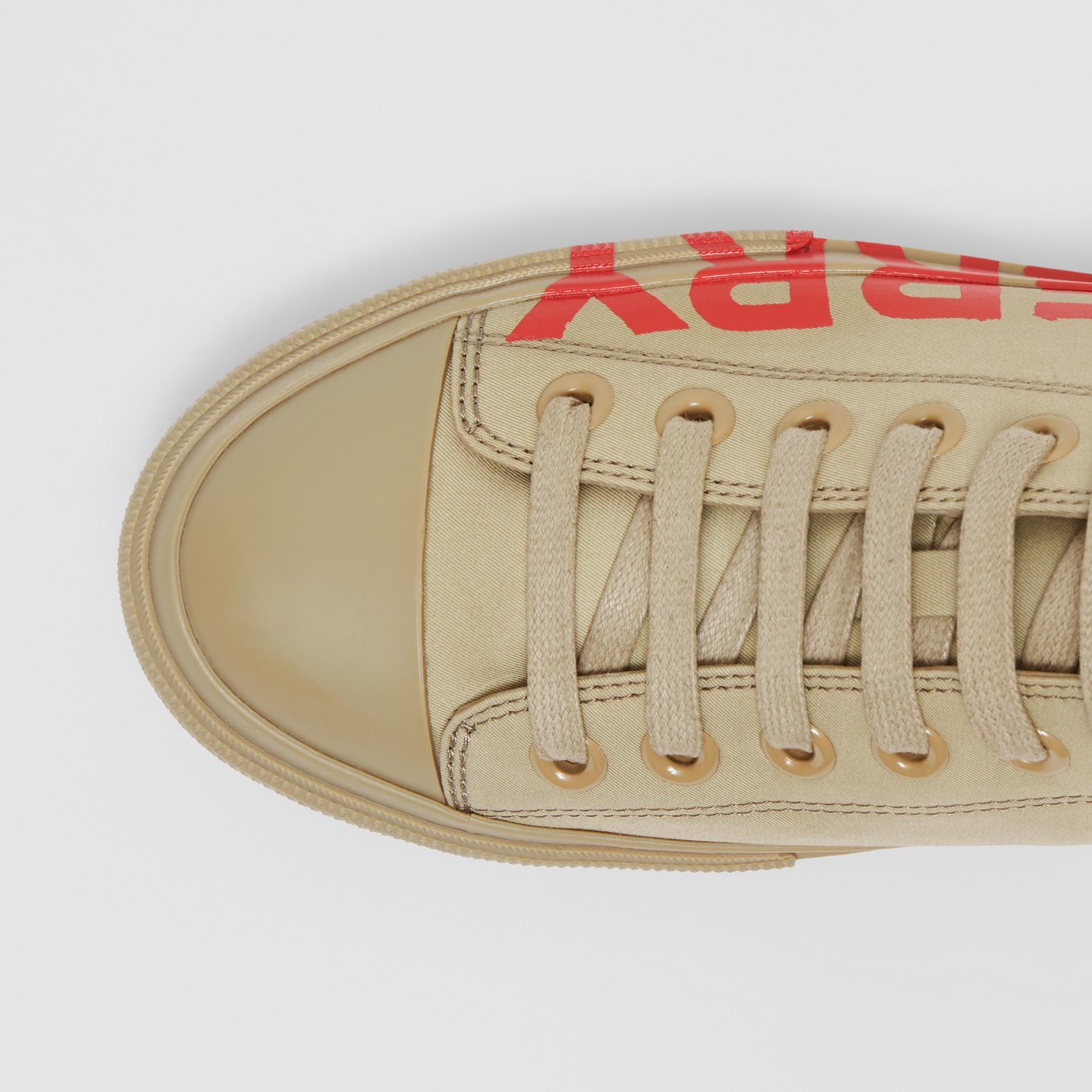 Logo Print Cotton Gabardine Sneakers in Dark Honey - Women | Burberry - gallery image 1