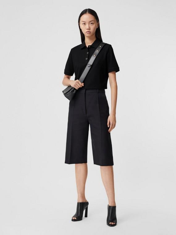 Poloshirt aus Baumwollpiqué mit Monogrammmotiv (Schwarz)
