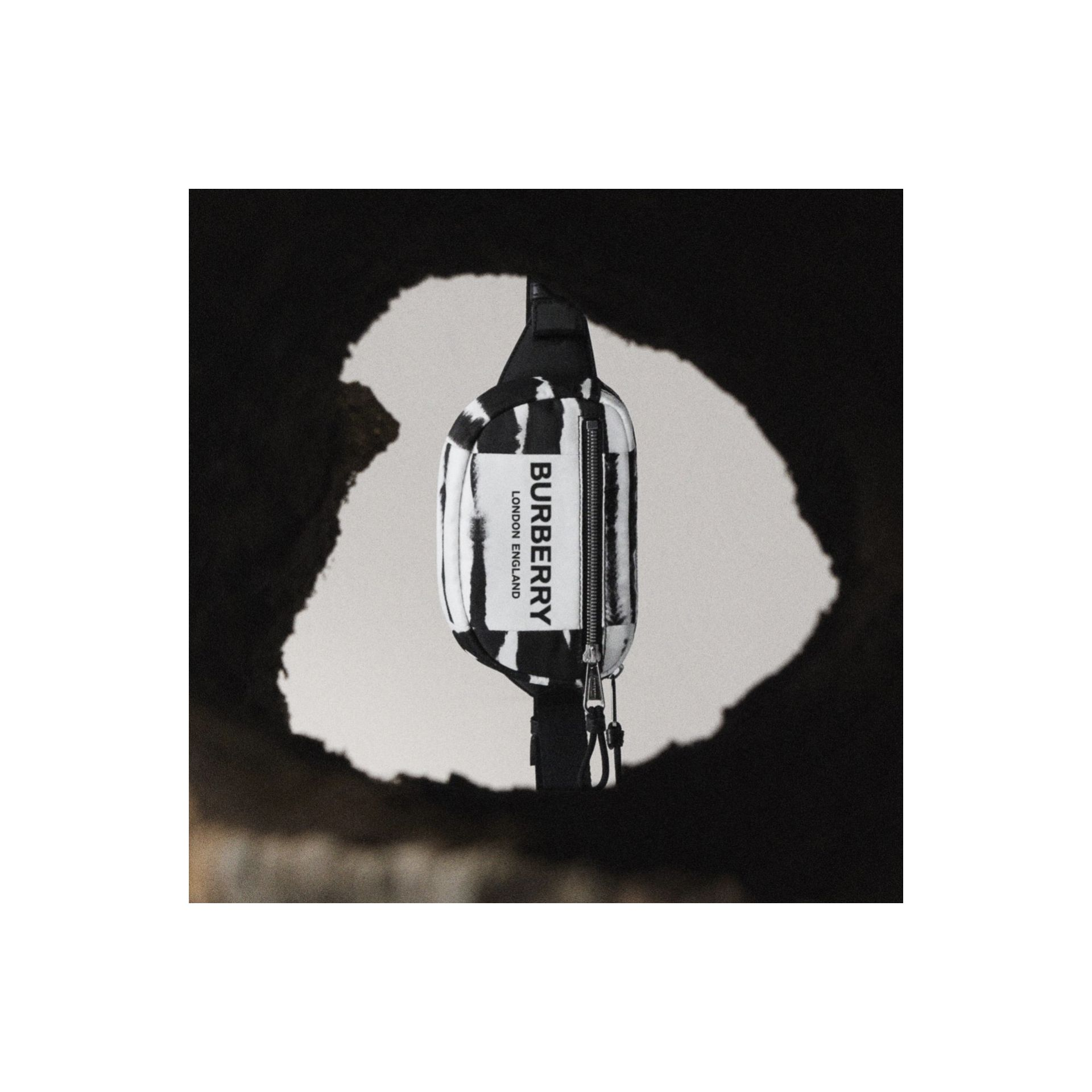 Small Watercolour Print ECONYL® Cannon Bum Bag in Black/white - Men   Burberry - gallery image 1