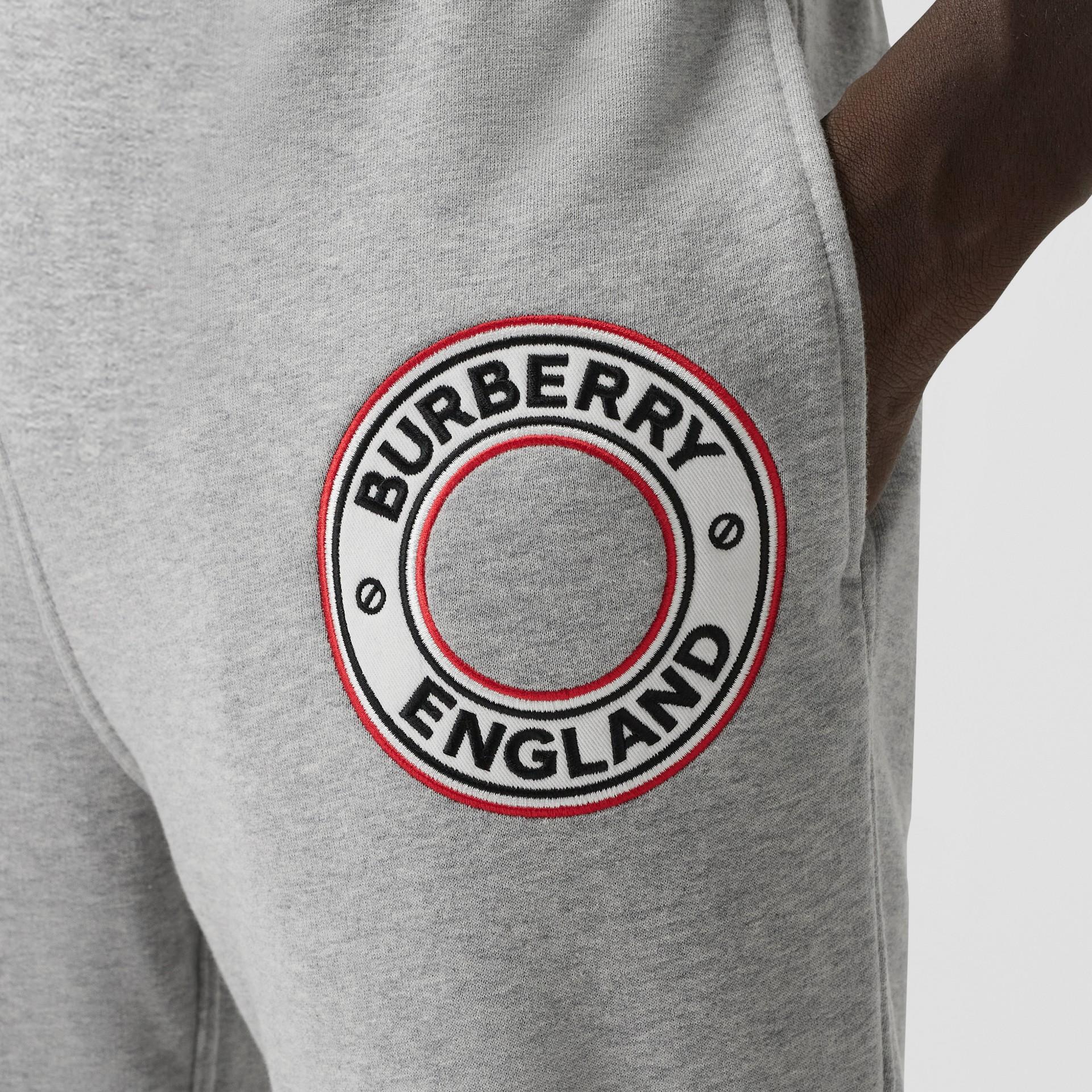 Logo Graphic Appliqué Cotton Jogging Pants in Pale Grey Melange - Men | Burberry - gallery image 1