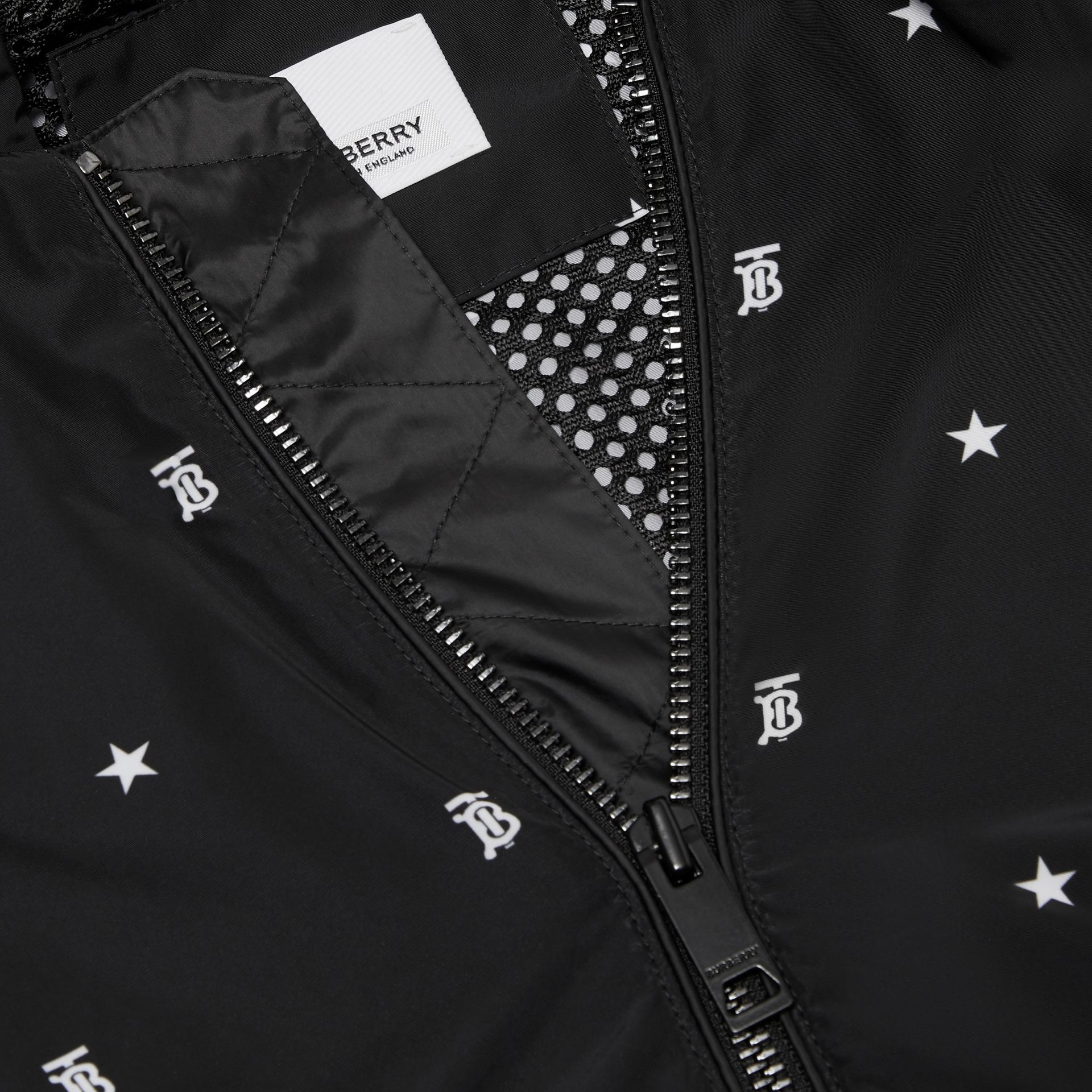 Star and Monogram Motif Lightweight Hooded Jacket in Black | Burberry Canada - gallery image 1