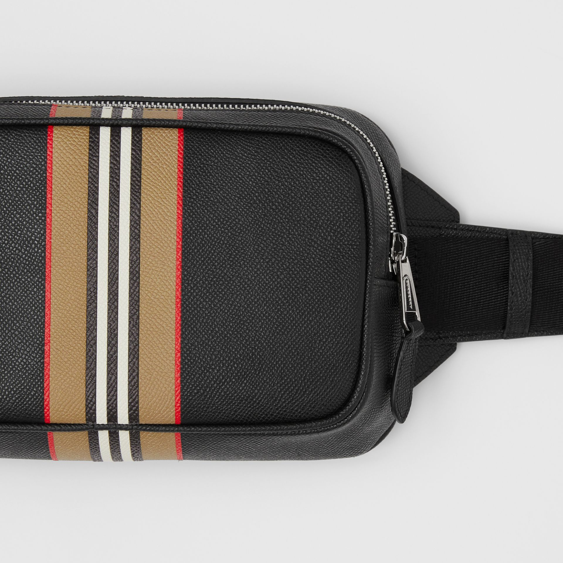 Icon Stripe Print Grainy Leather Bum Bag in Black - Men | Burberry - gallery image 1