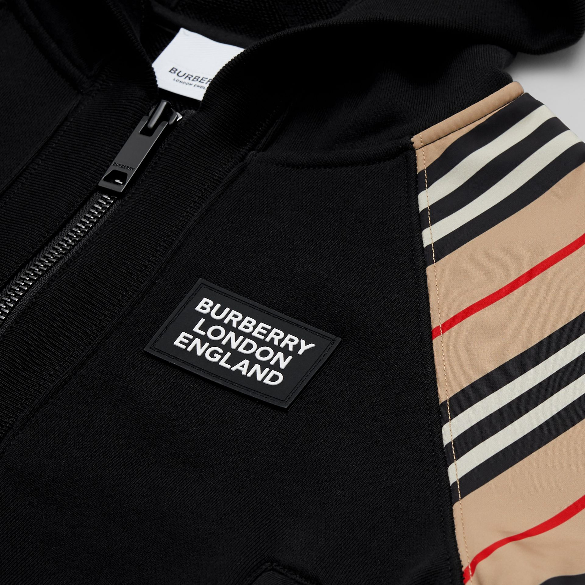 Icon Stripe Panel Cotton Hooded Top in Black | Burberry United Kingdom - gallery image 1