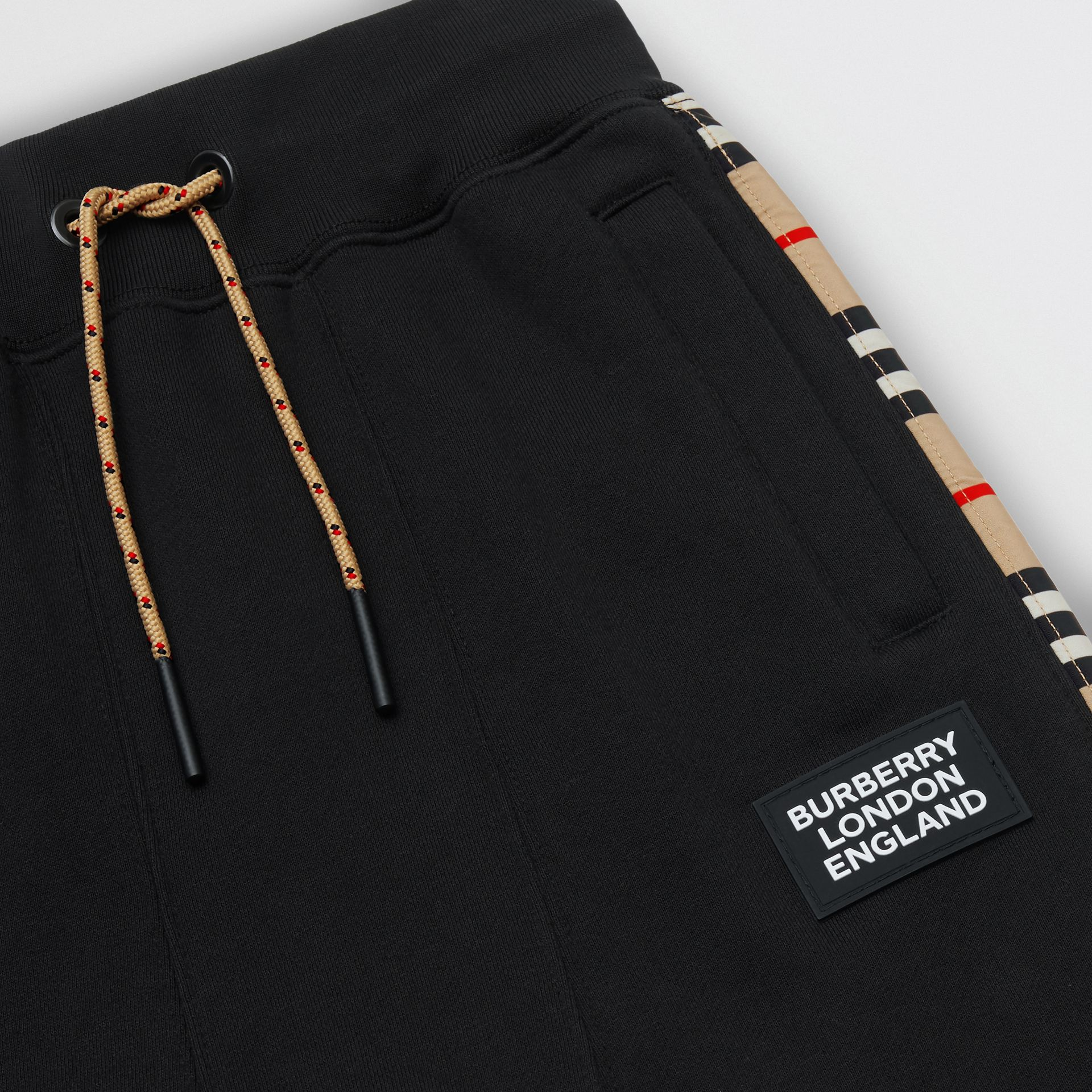 Icon Stripe Panel Cotton Trackpants in Black | Burberry United Kingdom - gallery image 1
