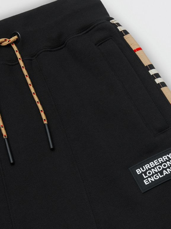 Icon Stripe Panel Cotton Trackpants in Black | Burberry United Kingdom - cell image 1
