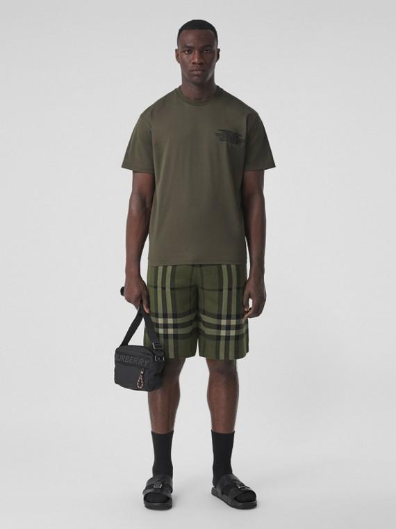 Oversize-T-Shirt aus Baumwolle mit Destinations-Aufdruck (Dunkles Olivfarben)