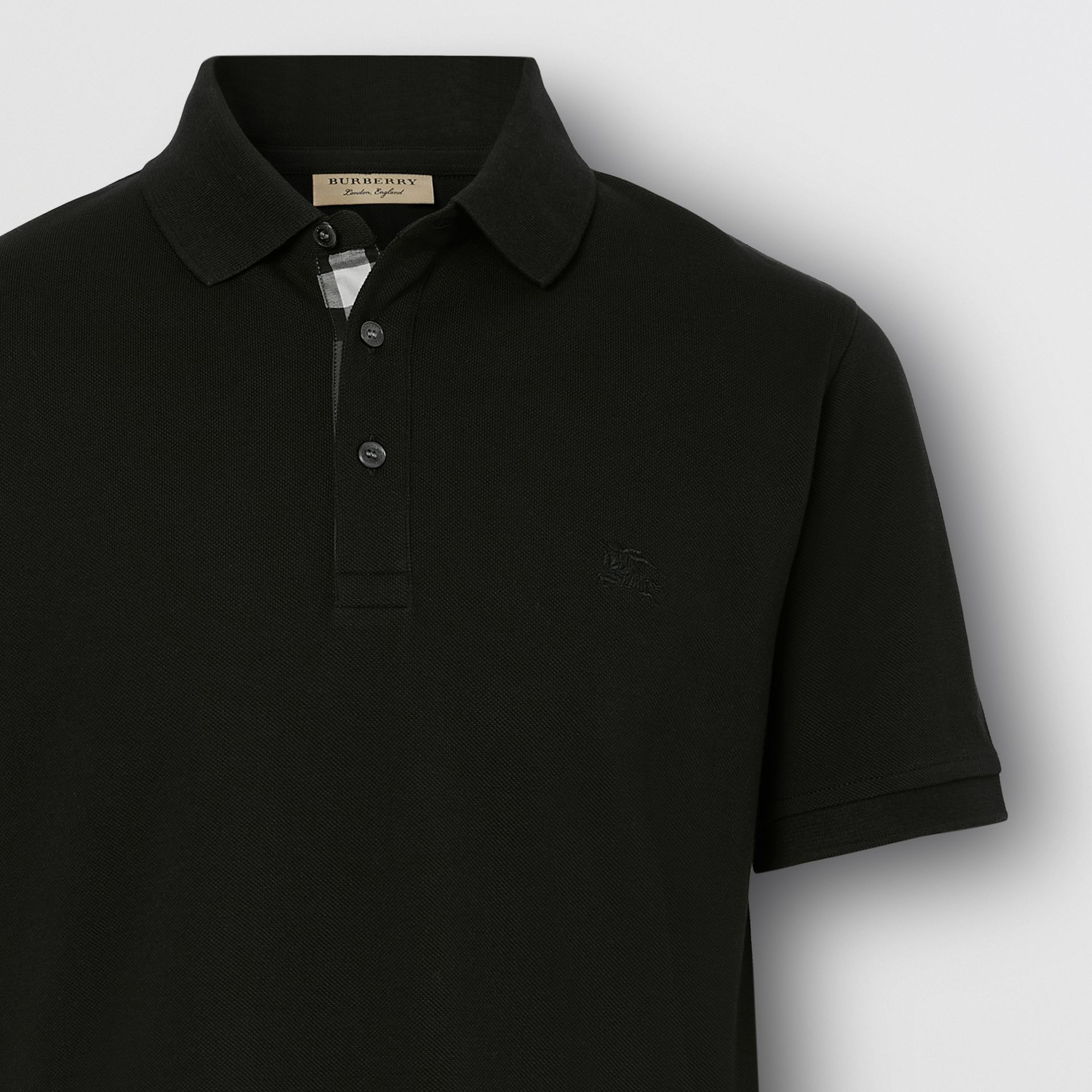 Check Placket Cotton Piqué Polo Shirt in Black - Men | Burberry - gallery image 1