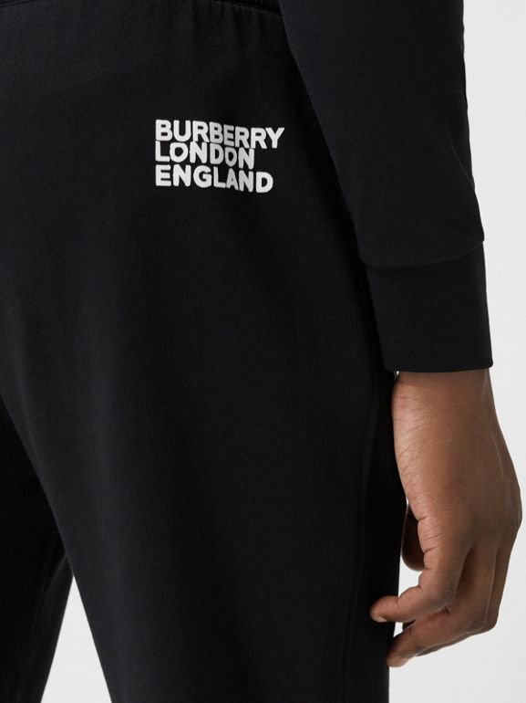 Love Print Cotton Jogging Pants in Black - Men | Burberry - cell image 1