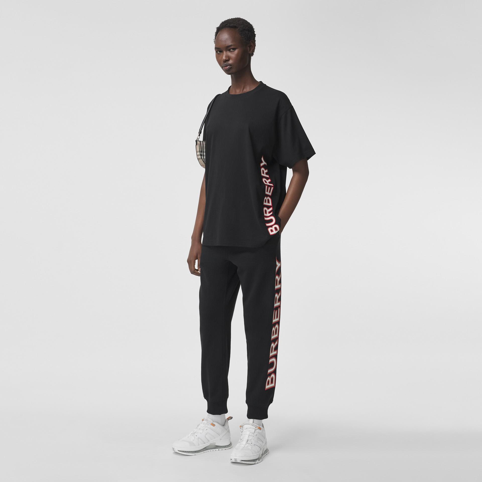 Logo Print Cotton Oversized T-shirt in Black - Women | Burberry - gallery image 0