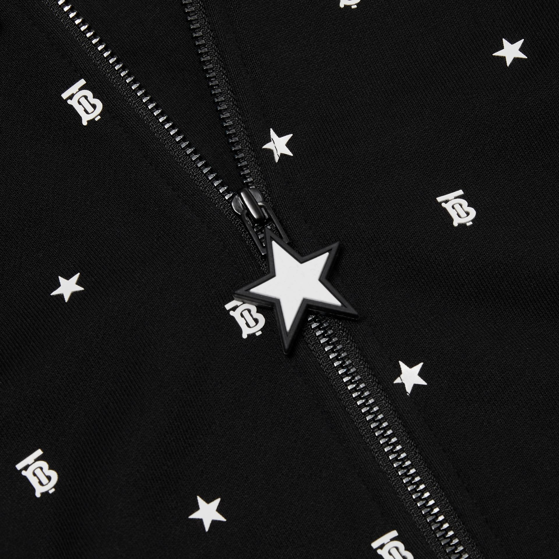 Star and Monogram Motif Cotton Hooded Top in Black - Children | Burberry - gallery image 1