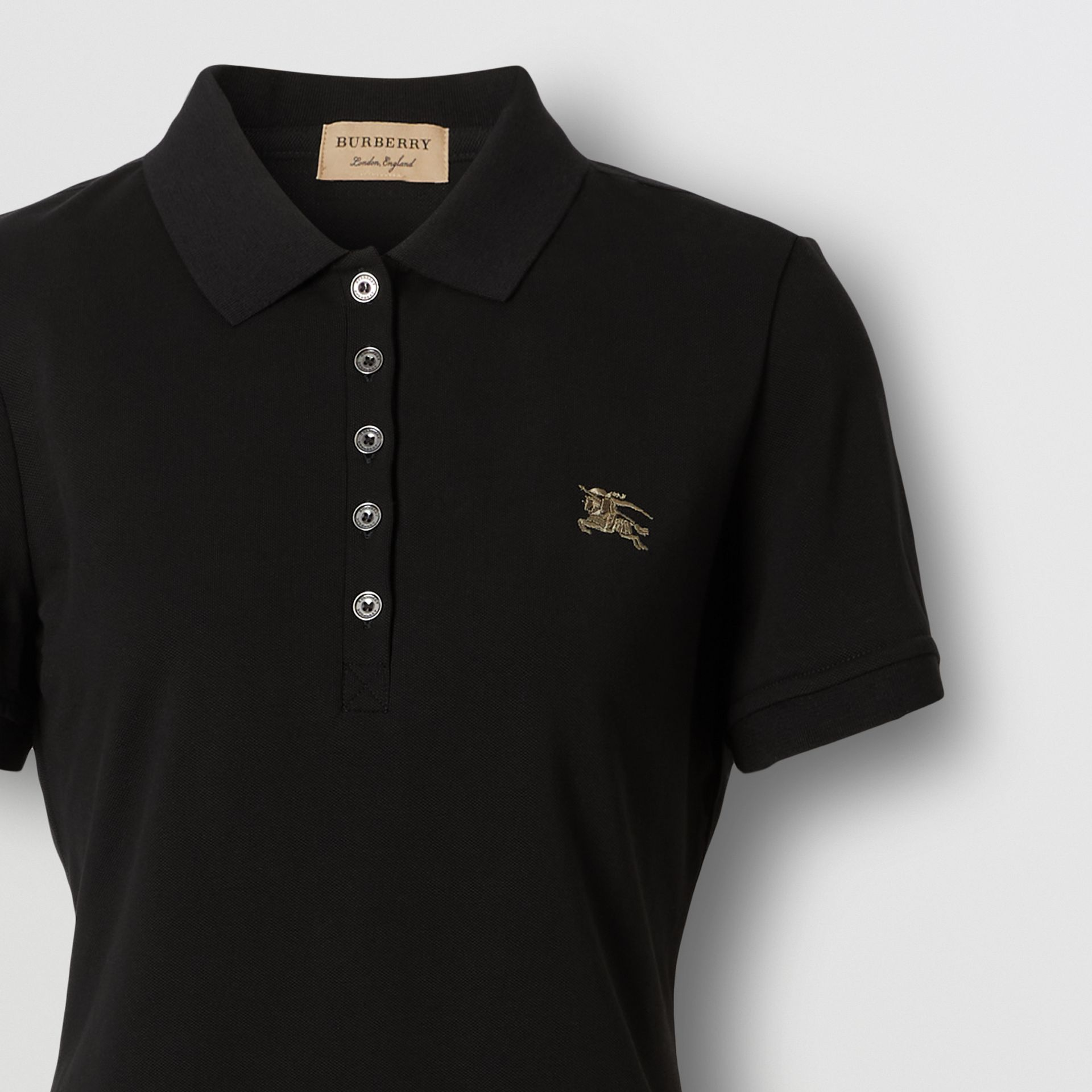 Check Trim Stretch Cotton Polo Shirt in Black - Women | Burberry - gallery image 1
