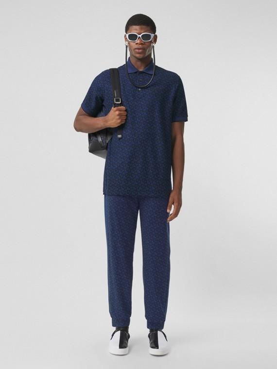 Pantaloni da jogging in cotone piqué con stampa monogramma a righe - Esclusiva online (Blu Reale Scuro)