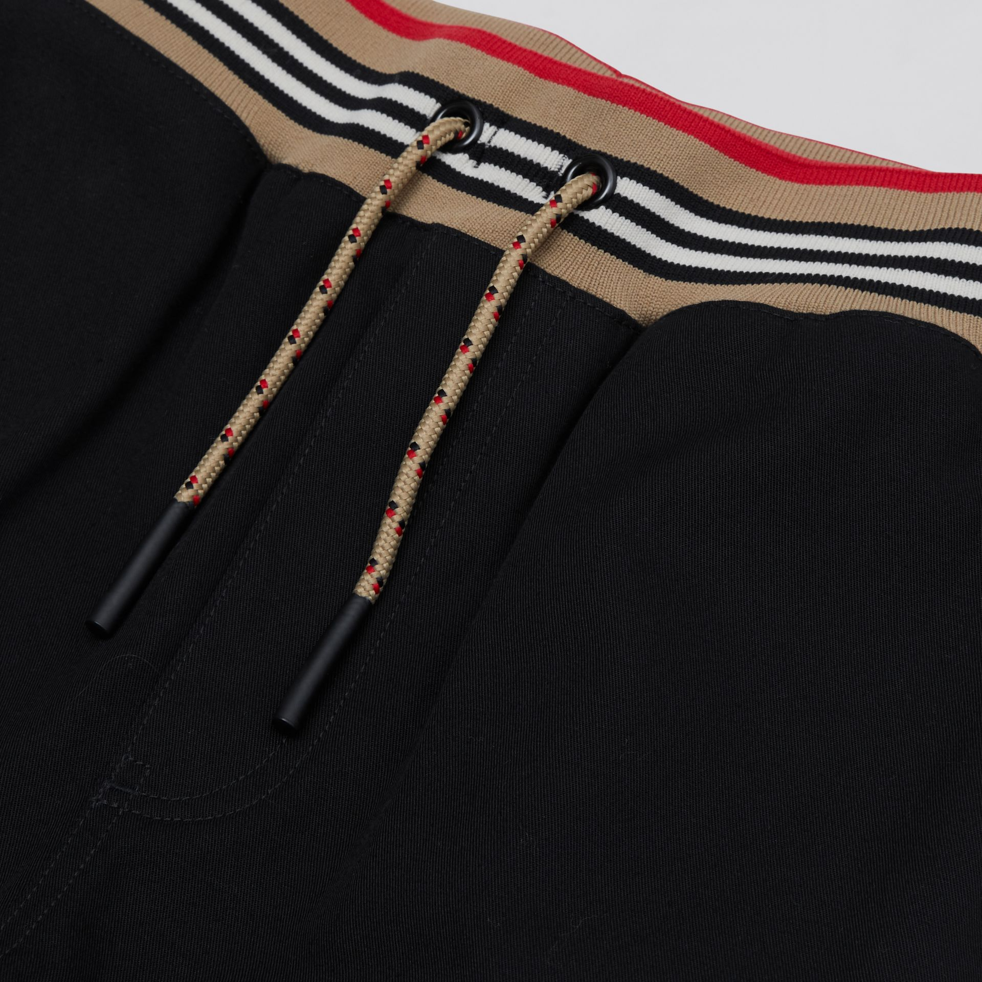 Icon Stripe Detail Cotton Twill Drawcord Trousers | Burberry United Kingdom - gallery image 1