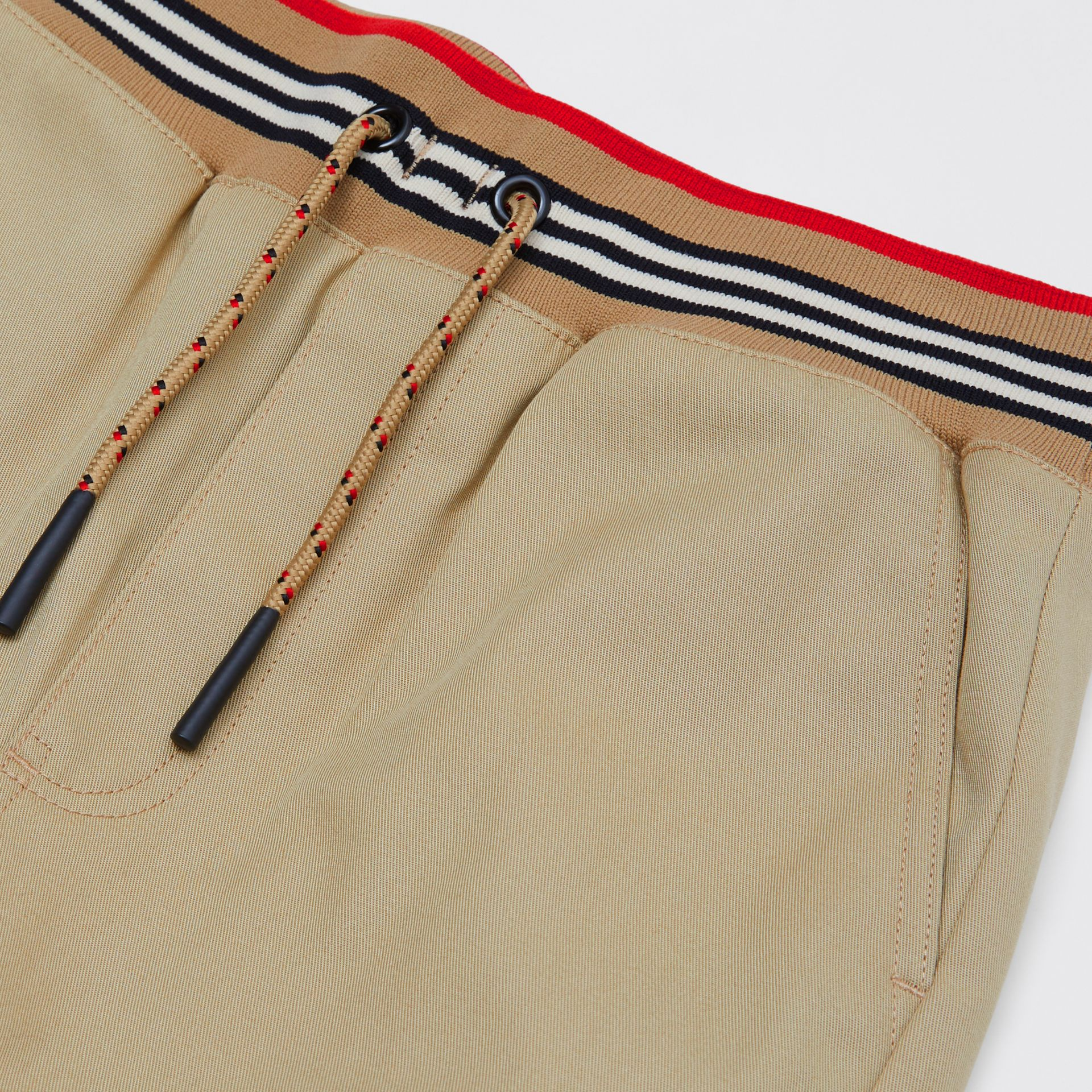 Icon Stripe Detail Cotton Twill Drawcord Trousers in Honey   Burberry United Kingdom - gallery image 1