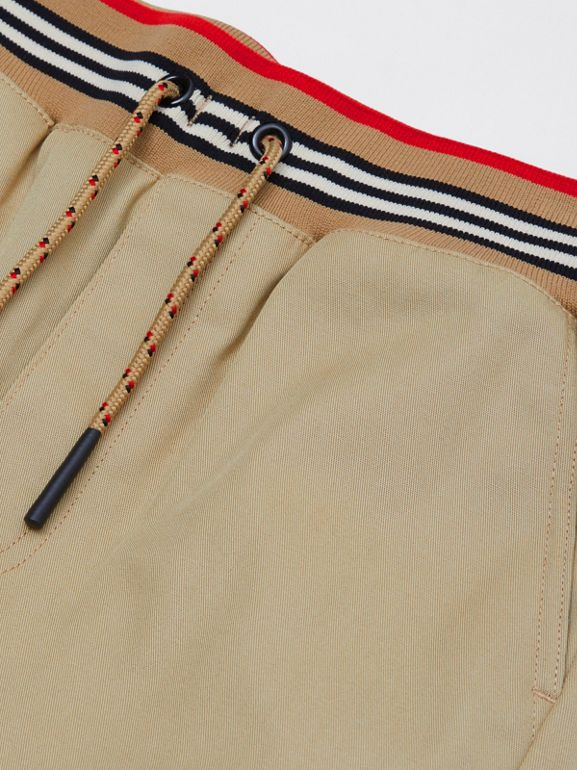 Icon Stripe Detail Cotton Twill Drawcord Trousers in Honey   Burberry United Kingdom - cell image 1