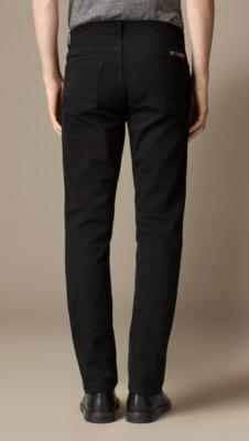 斯温黑色锥形紧腿牛仔裤图片