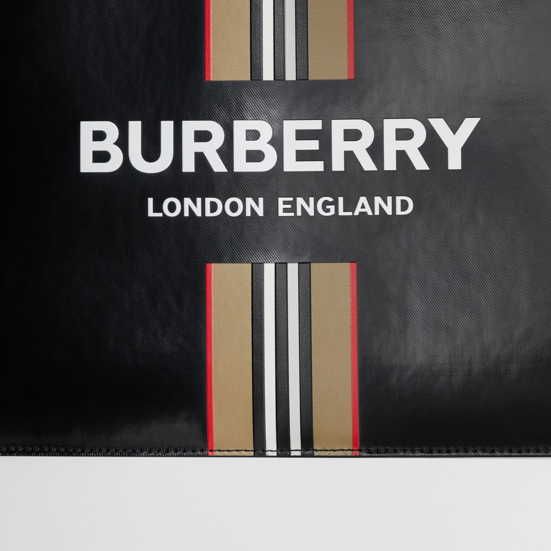Logo and Icon Stripe Print Coated Canvas Zip Pouch in Black | Burberry United States - gallery image 1