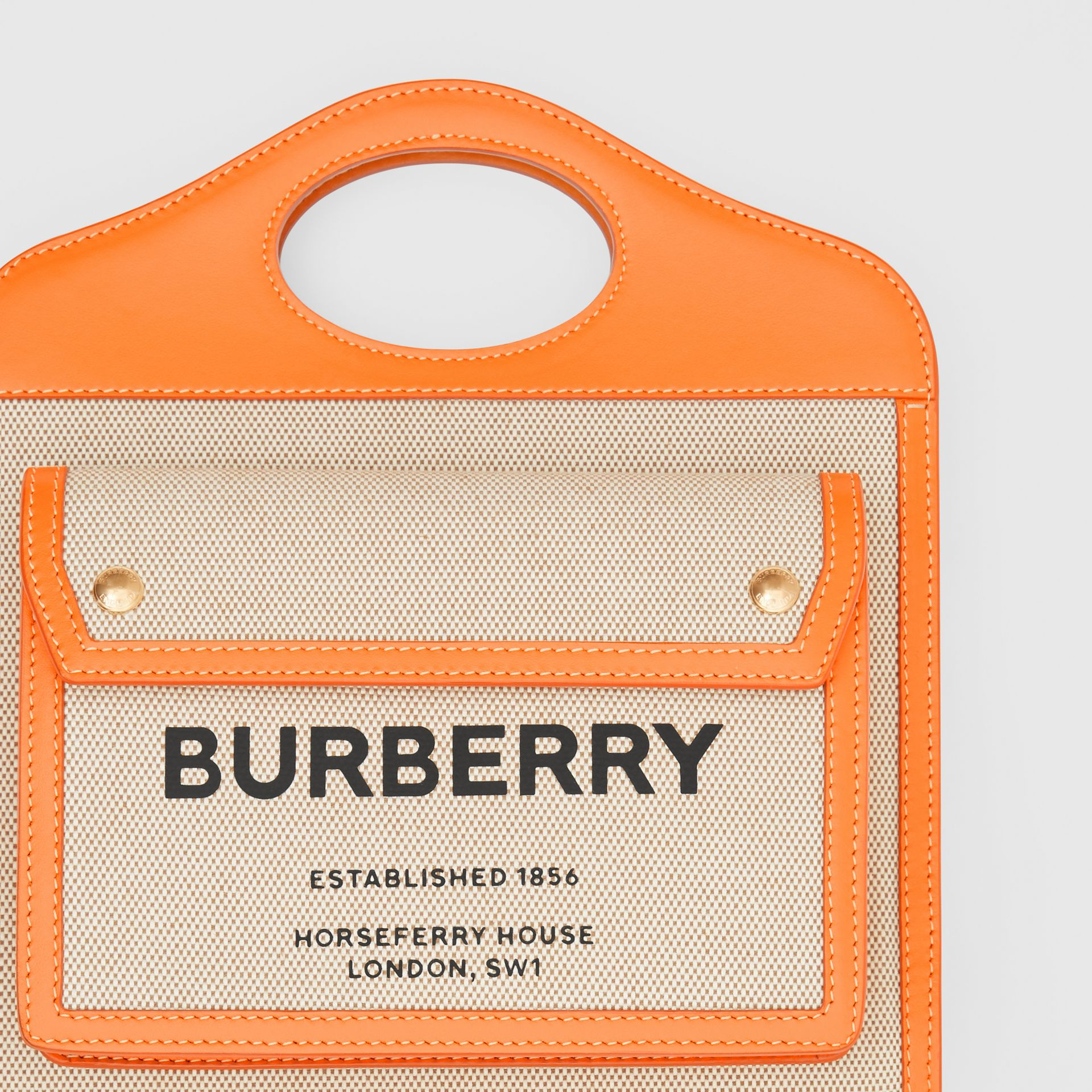 Mini Two-tone Canvas and Leather Pocket Bag in Orange - Women | Burberry - gallery image 1