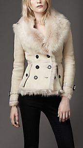 Giacca in shearling con finitura in pelle