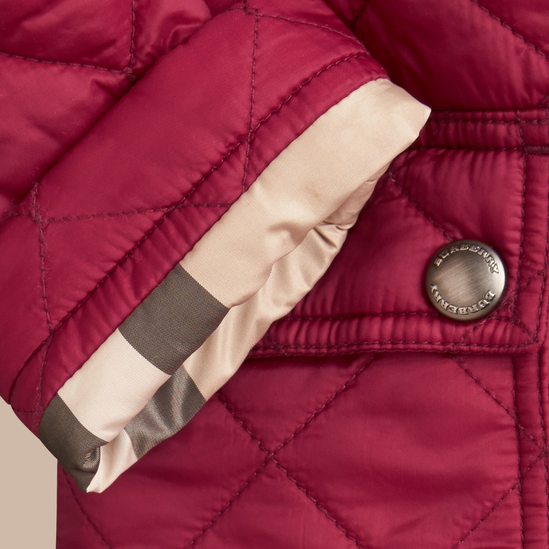 Quilted Jacket with detachable hood in Fritillary Pink - Girl | Burberry - gallery image 1