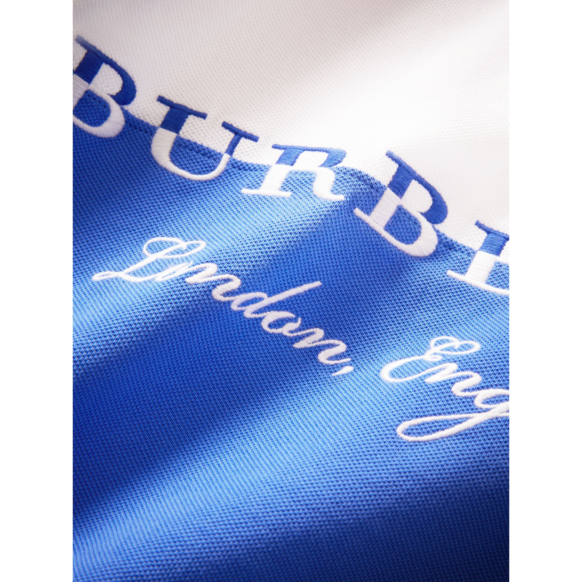 Embroidered Two-tone Cotton Piqué Polo Shirt in Cobalt Blue - Boy | Burberry United Kingdom - gallery image 1