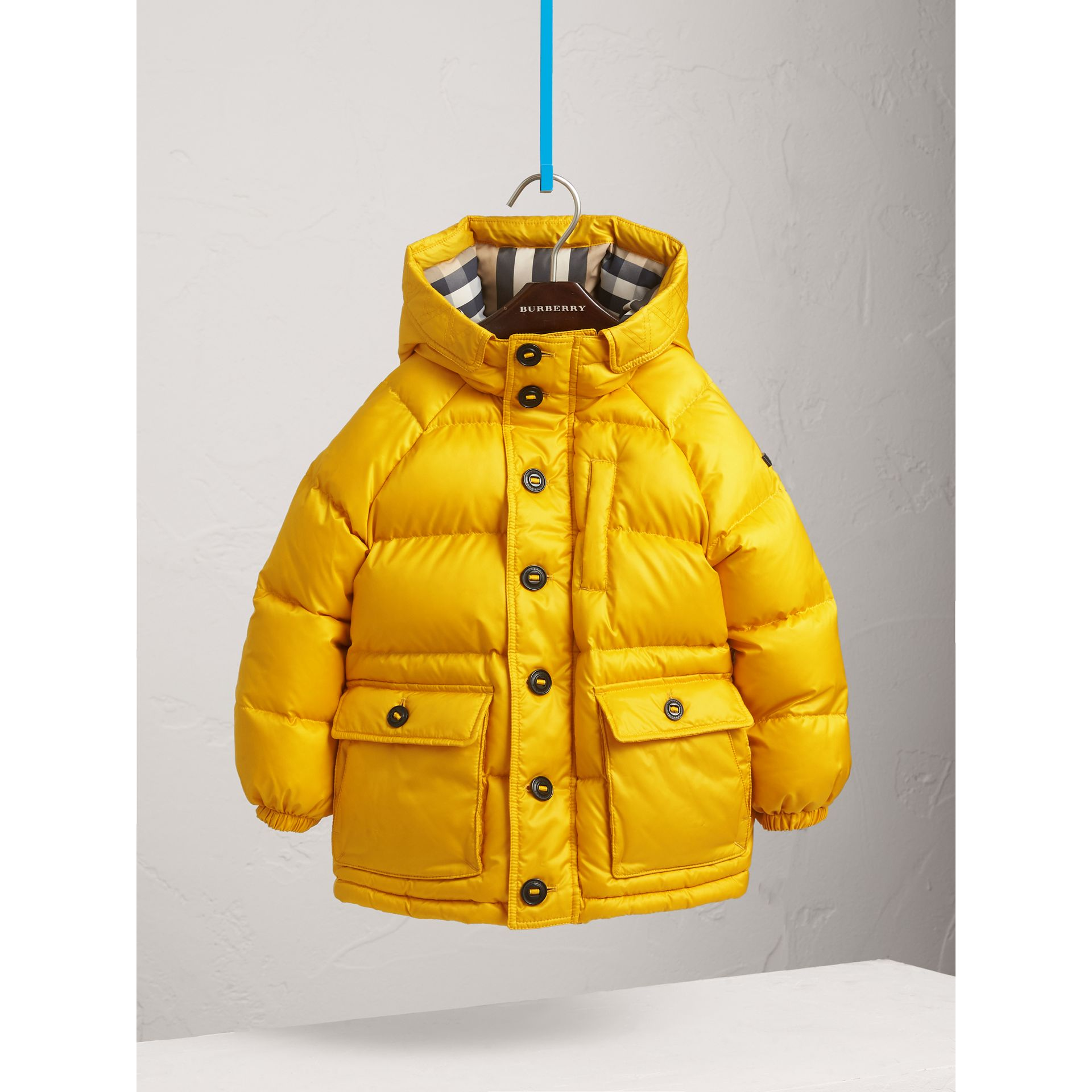 Shower-resistant Hooded Puffer Jacket in Larch Yellow - Boy | Burberry - gallery image 3