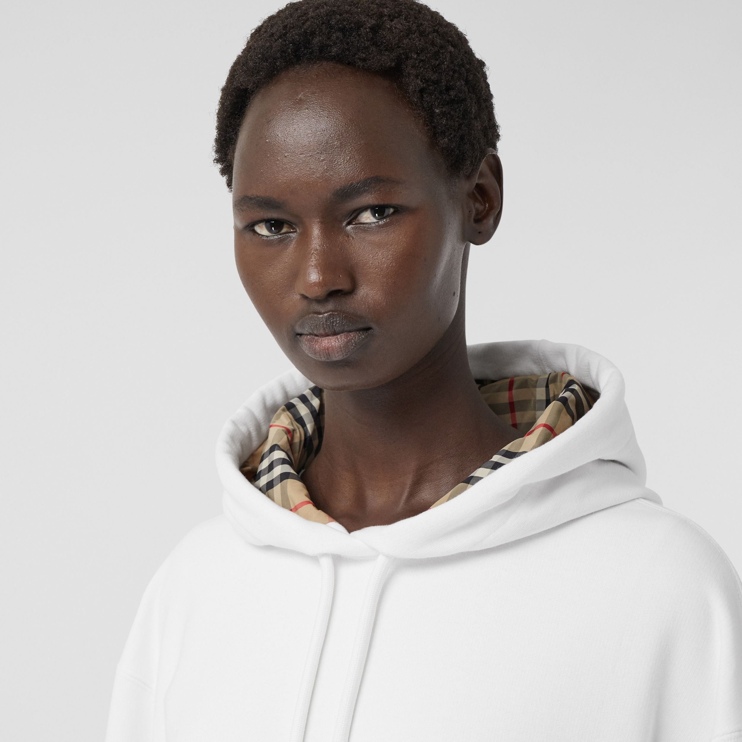 Stepped Hem Cotton Oversized Hoodie in White - Women | Burberry - 2
