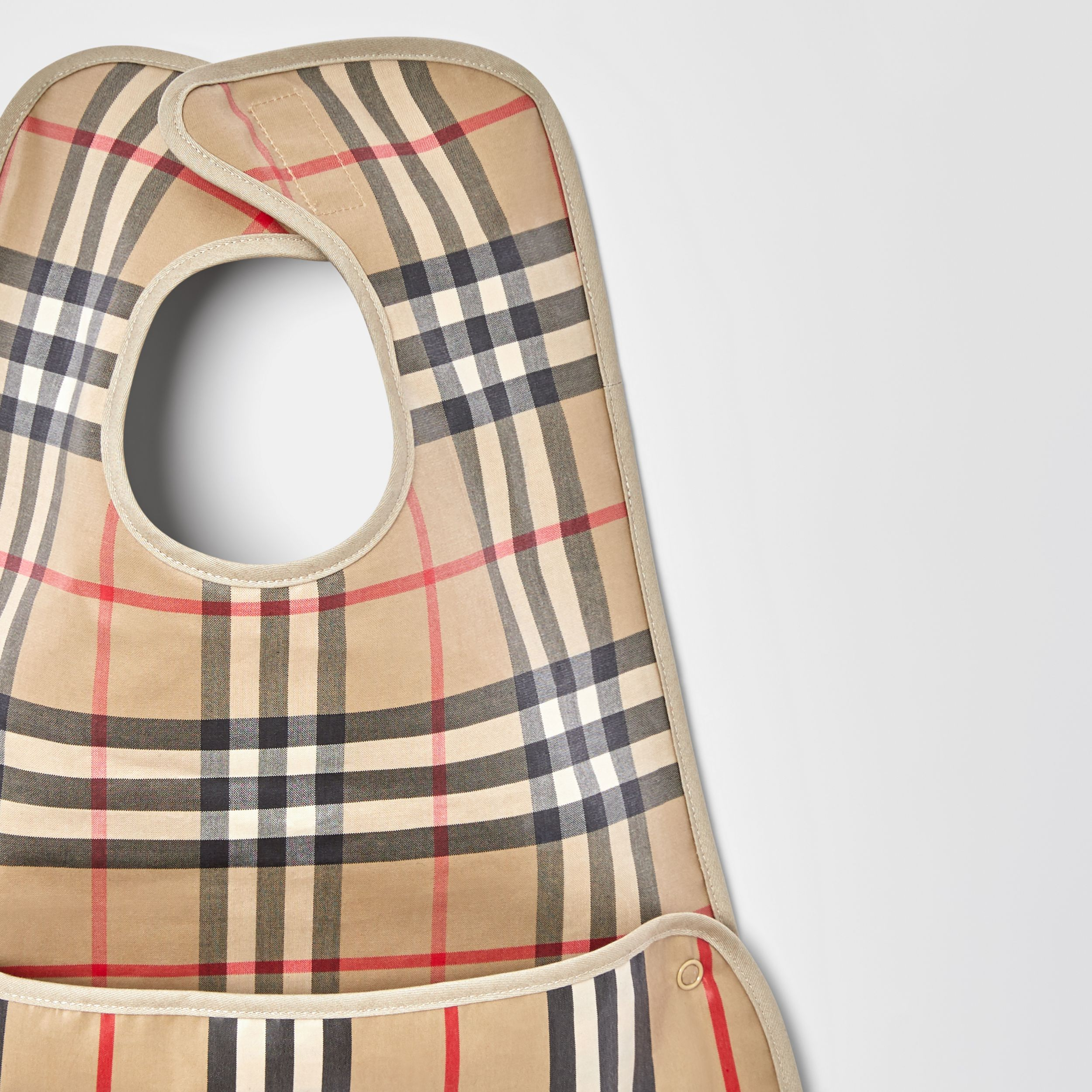 Coated Vintage Check and Icon Stripe Bib in Archive Beige - Children | Burberry - 4
