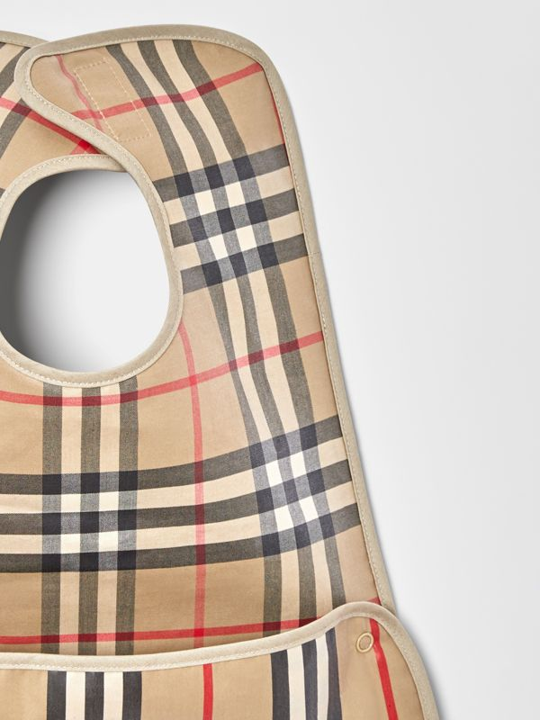 Coated Vintage Check and Icon Stripe Bib in Archive Beige - Children | Burberry United Kingdom - cell image 3