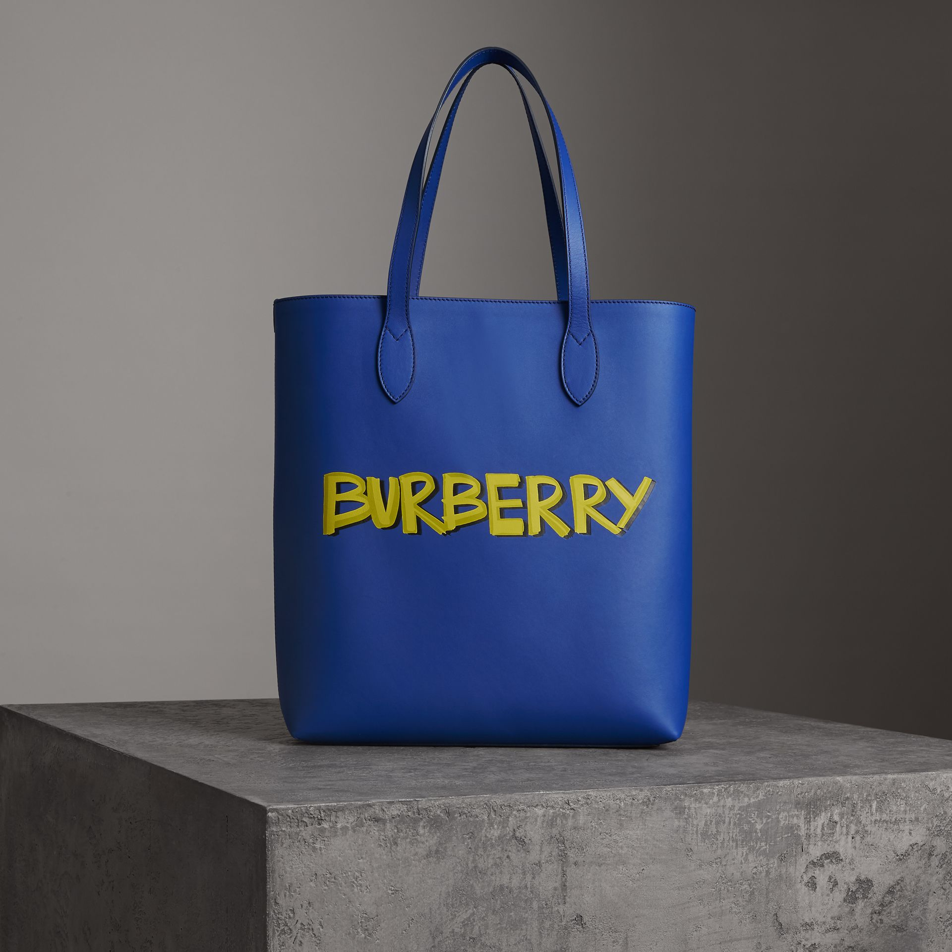 Graffiti Print Bonded Leather Tote in Denim Blue | Burberry - gallery image 0